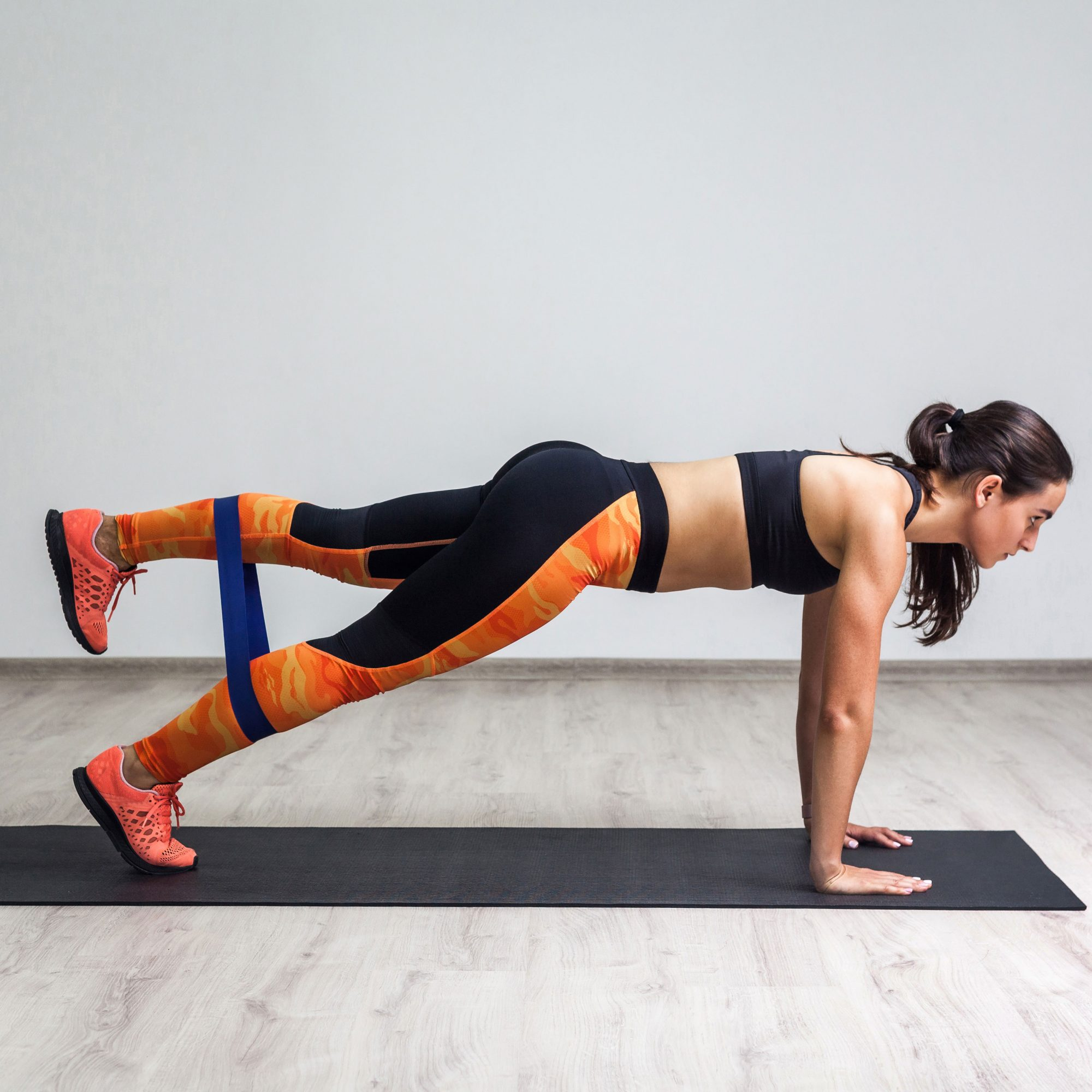 Woman_Doing_A_Push_Up_With_A_Single_Leg_Raised