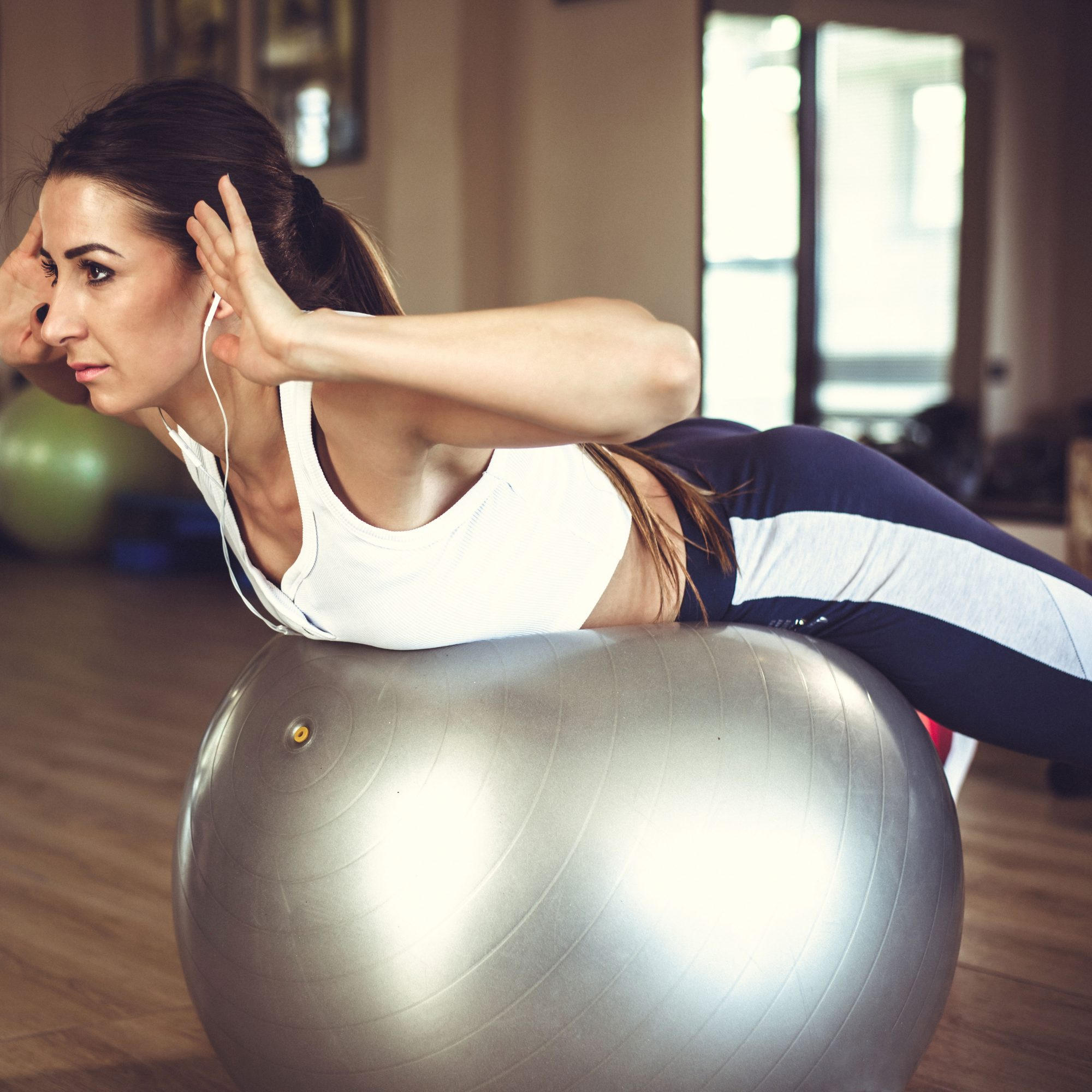 Woman_Doing_Stability_Ball_Shoulder_Stabilization