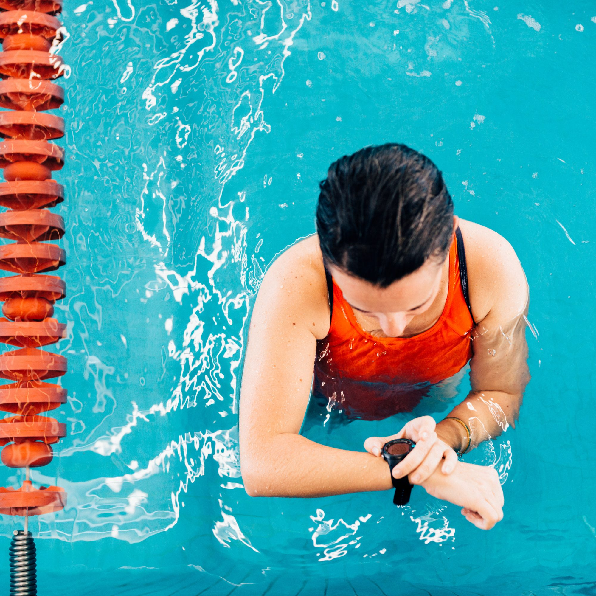 Woman_Checking_Watch_In_Pool