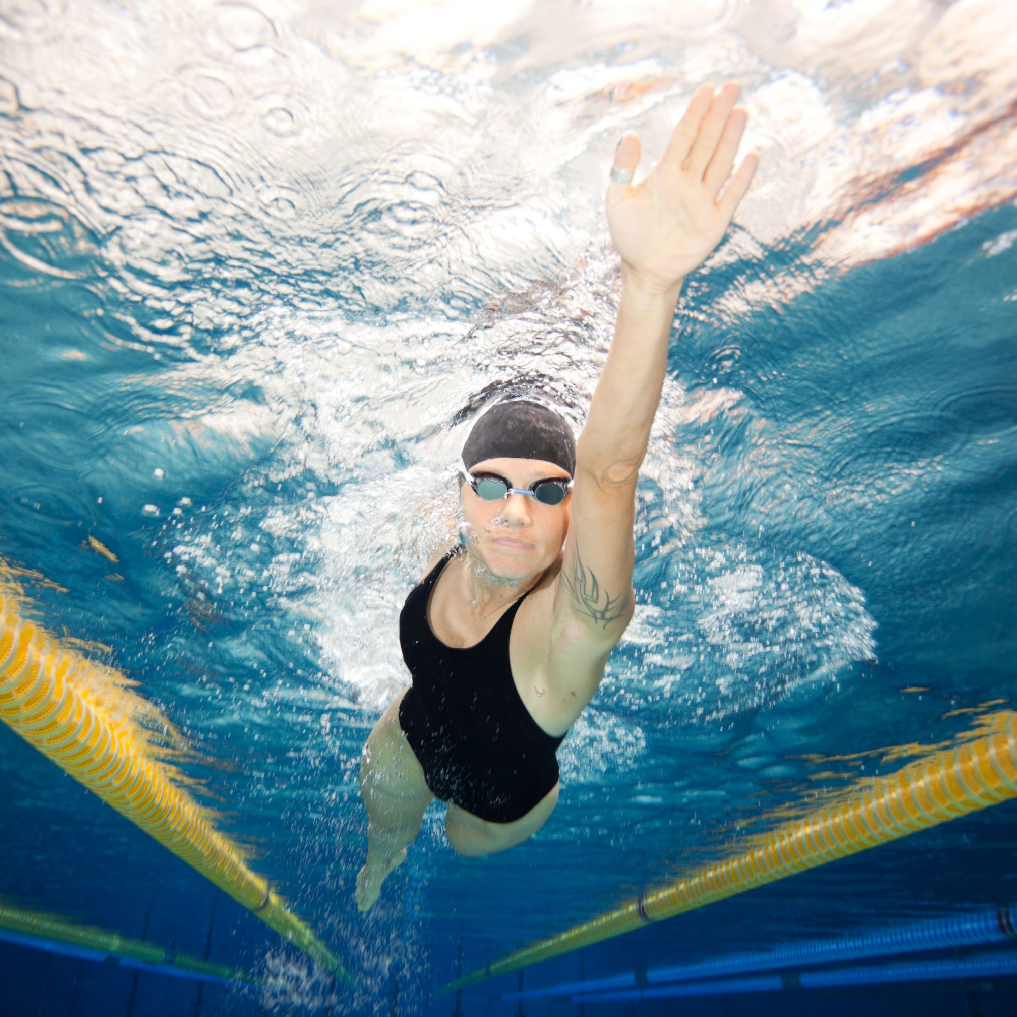 Under_Water_View_Of_Woman_Doing_Laps