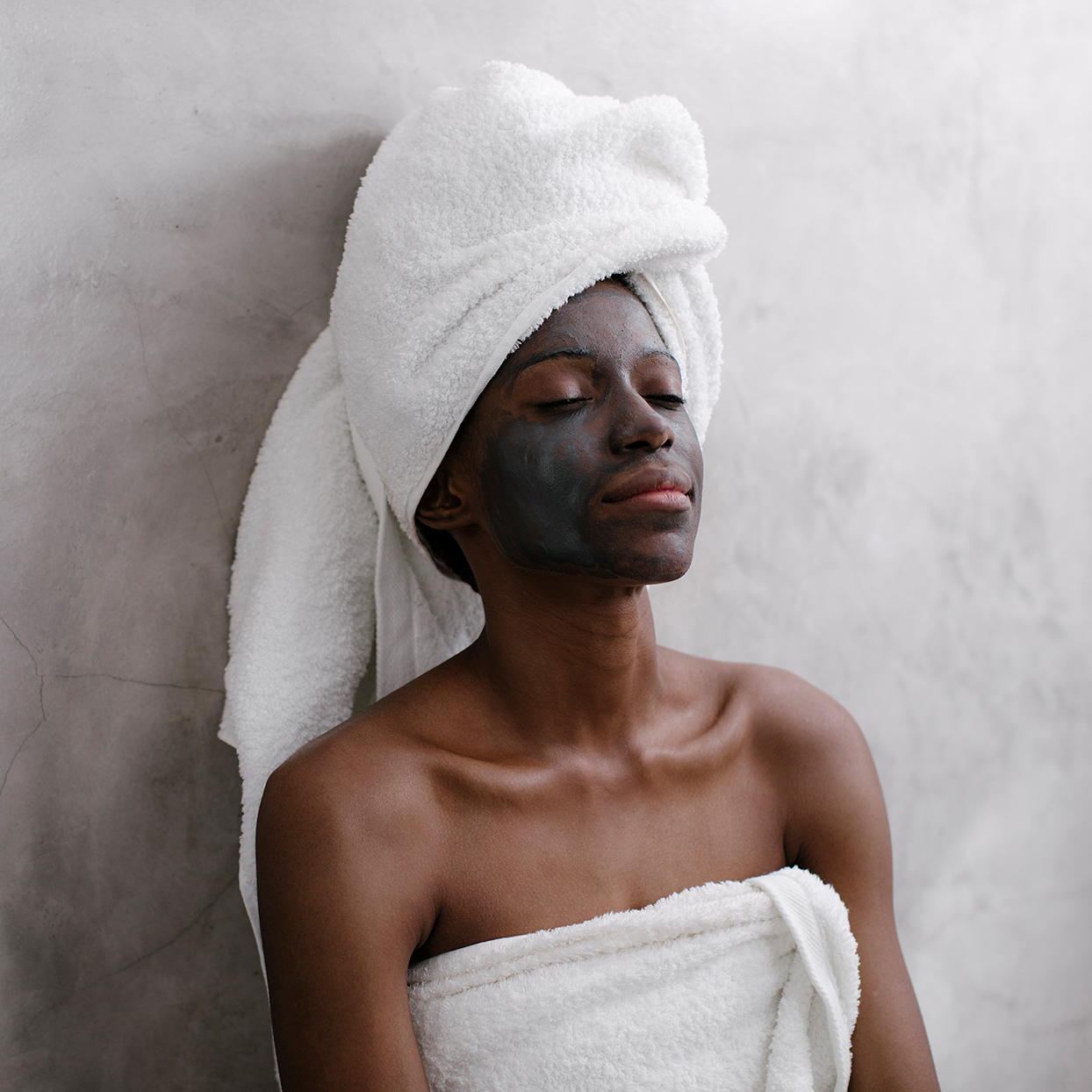 Woman using charcoal face mask
