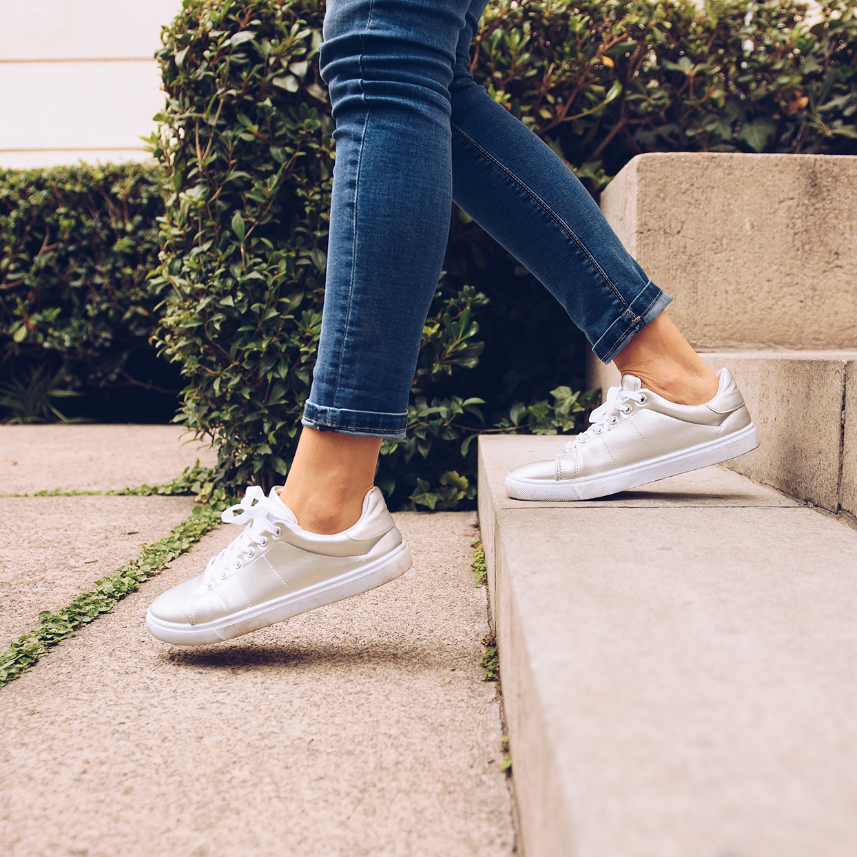 Woman walking in sneakers