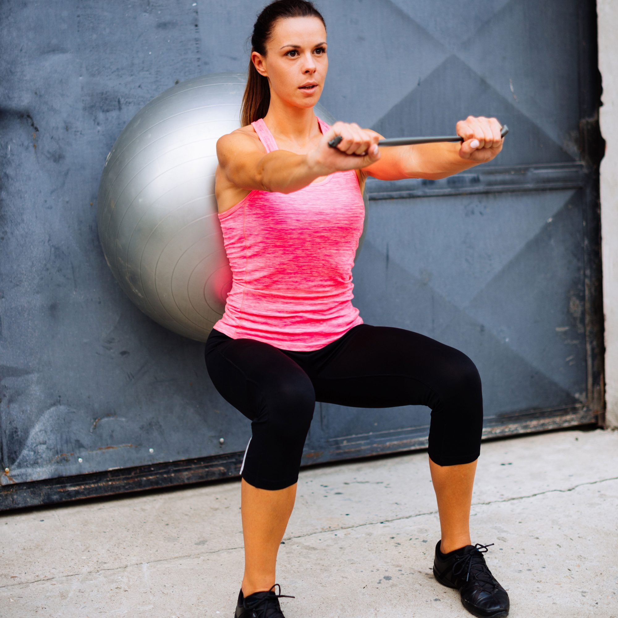 Woman_Doing_Wall_Squats_With_Swiss_Ball