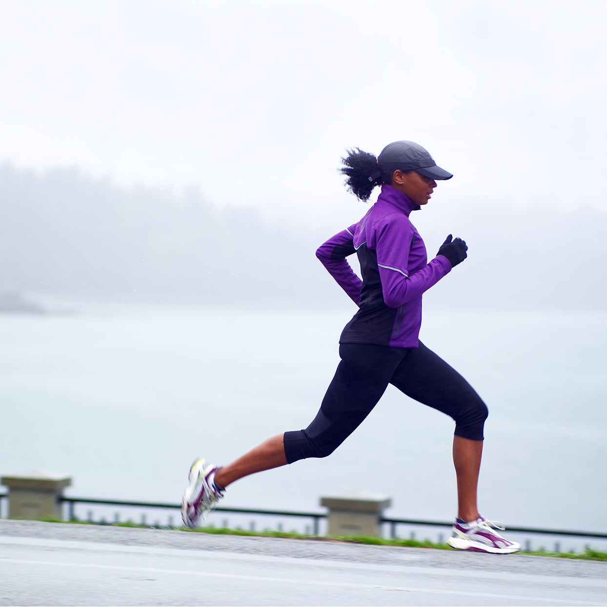 Woman running with gloves on