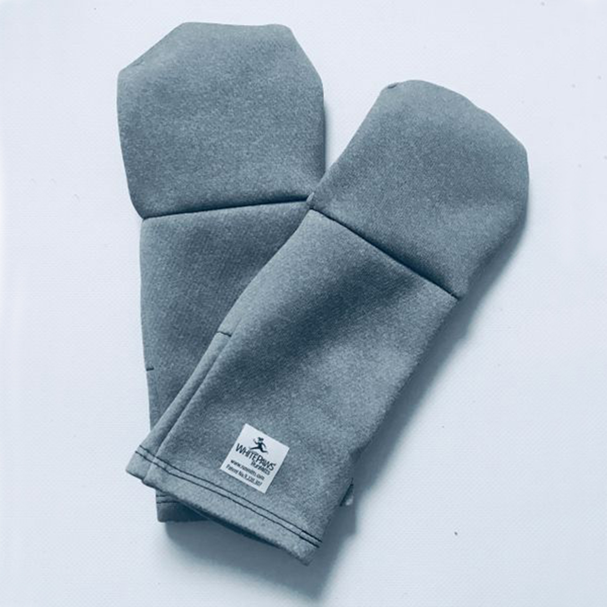 This convertible pair transitions from running gloves to mittens. Each pair has an inner pocket where you can store a hand warmer on the most frigid days.