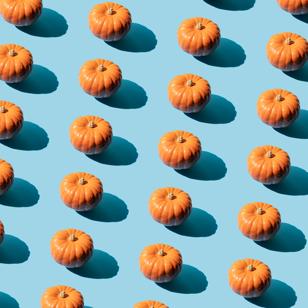 Repeated pumpkin on the blue background