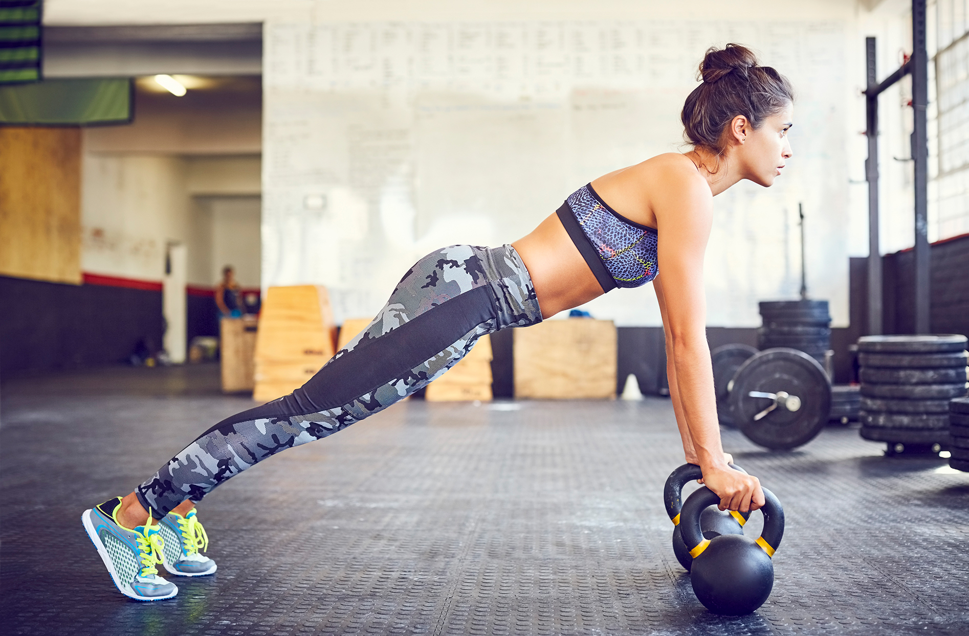 Woman performing a kettlebell arm workout