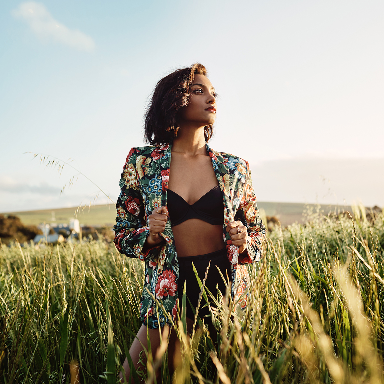 A woman wearing a comfy bra in a field