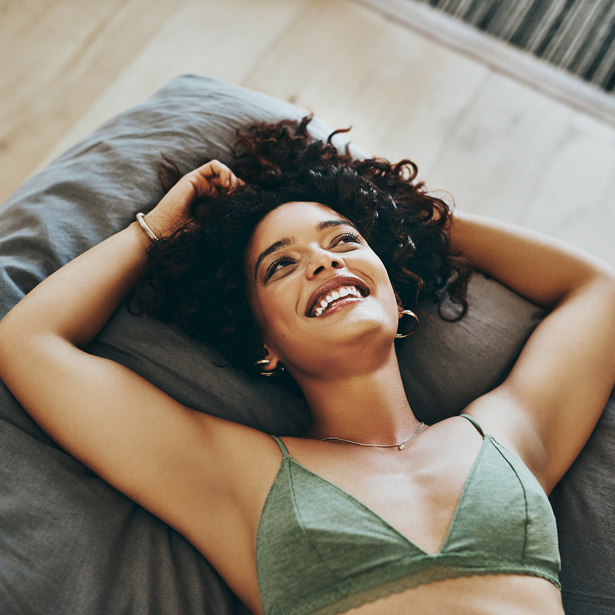 Woman lounging in a bralette