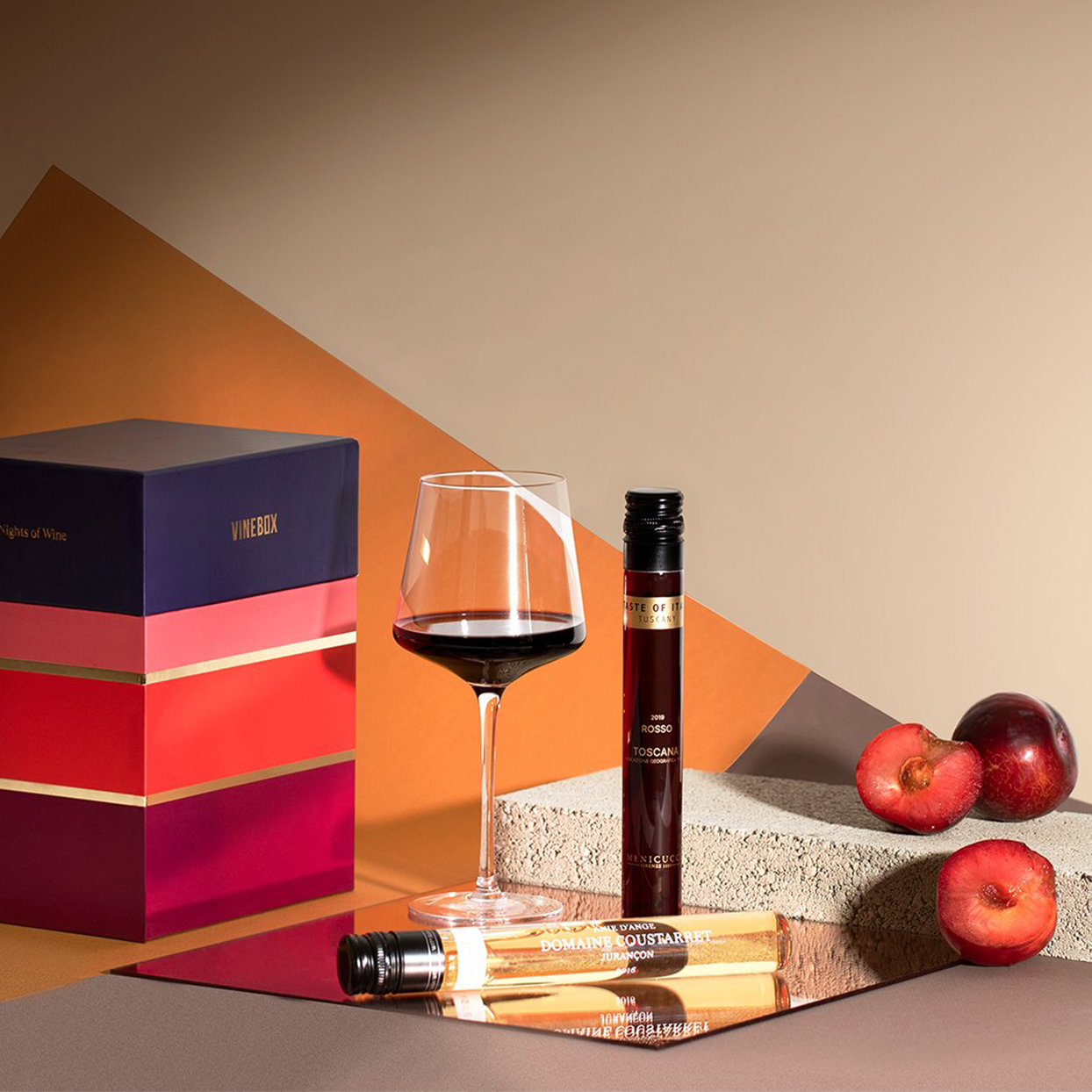 """Turns out a box of wine can make a really chic gift. Vinebox has a """"Twelve Nights of Wine"""" wine advent calendar with 12 individual glasses of reds and whites to enjoy throughout December. Each comes in a fancy-looking vial you'll want to show off.Related: The Best Shower Wine Glass Holders for $15 or Less"""