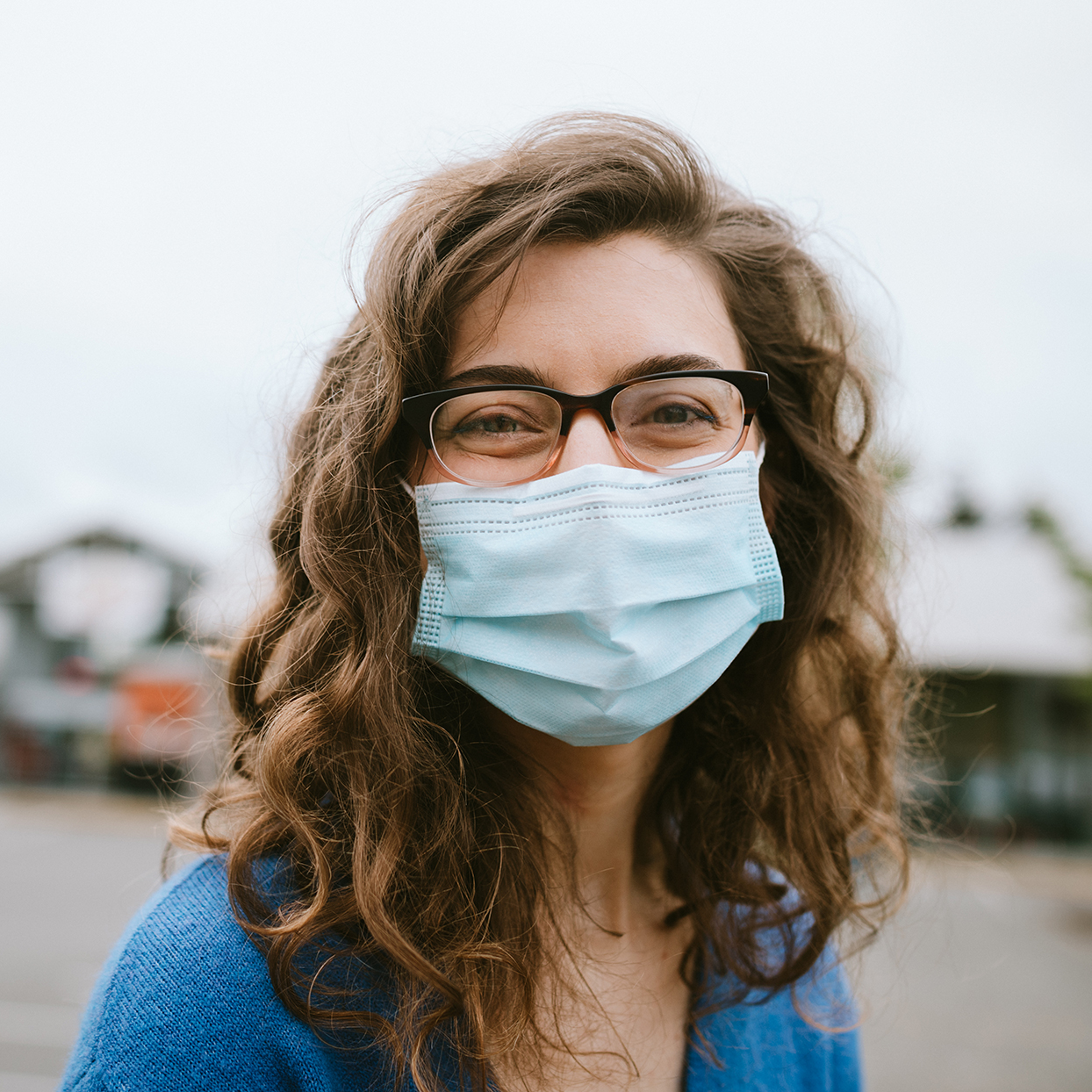 Woman wearing glasses and mask