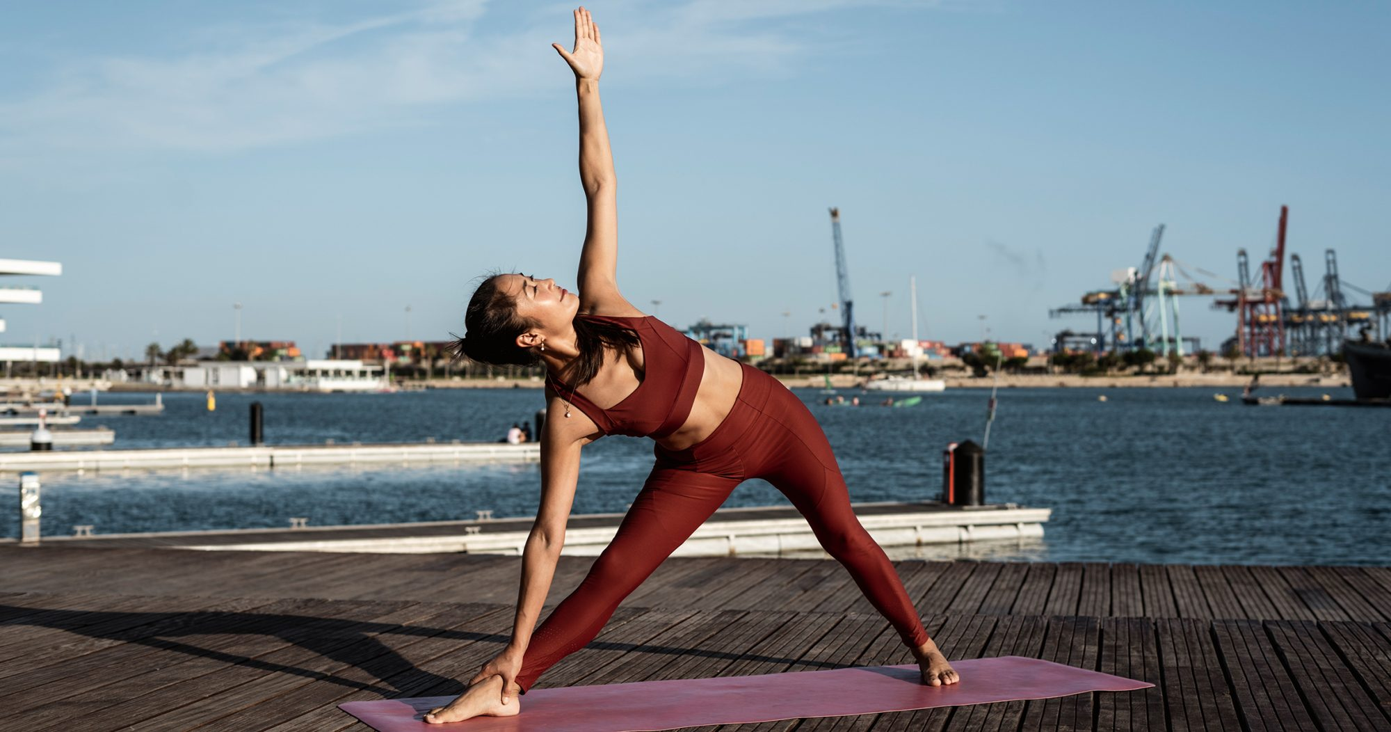Woman doing yoga in a matching sports bra and leggings