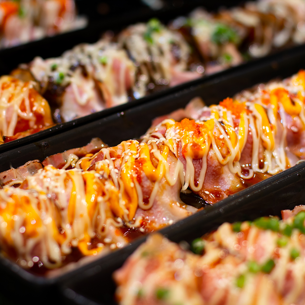 Sushi rolls drizzled with mayo