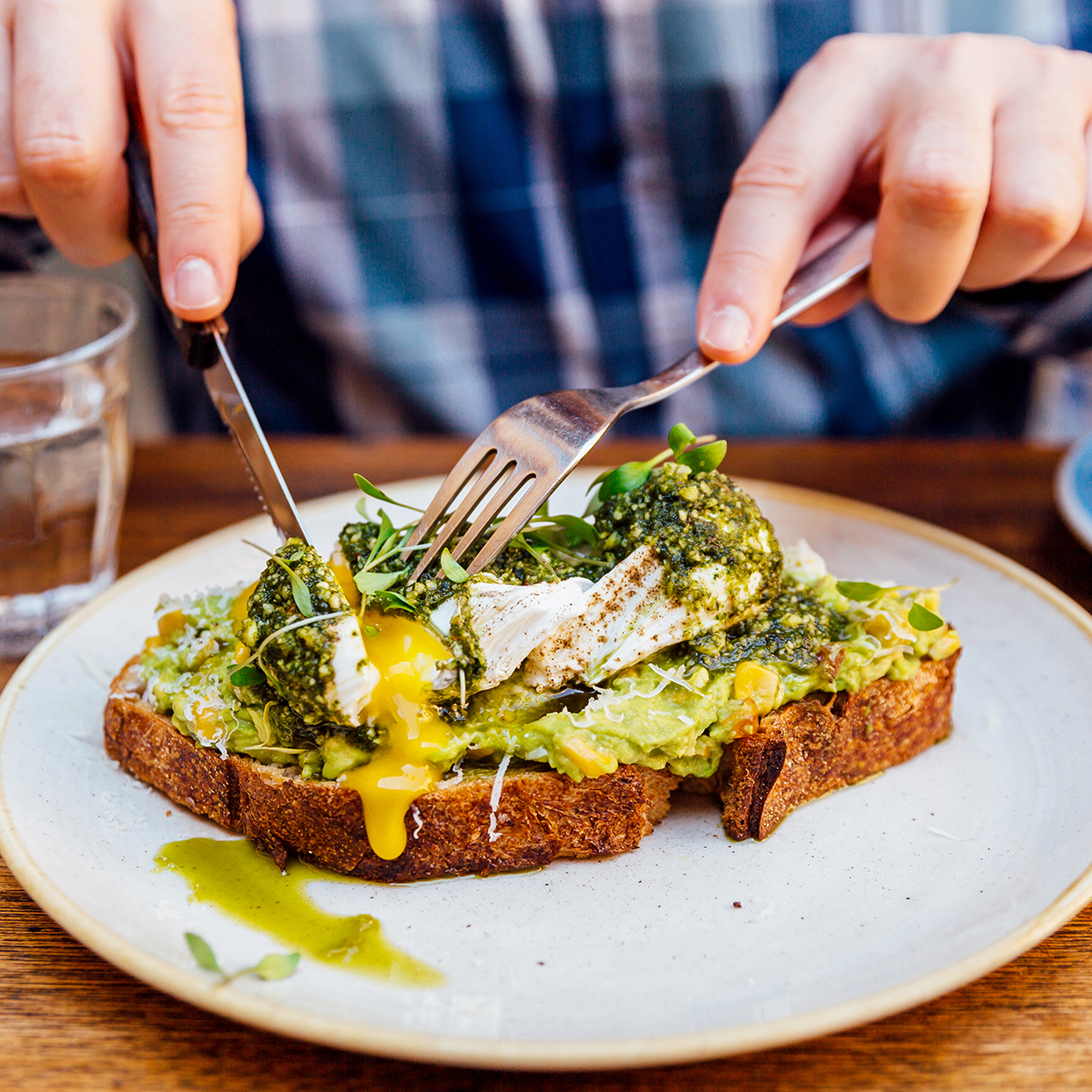 Eating avocado toast with an egg