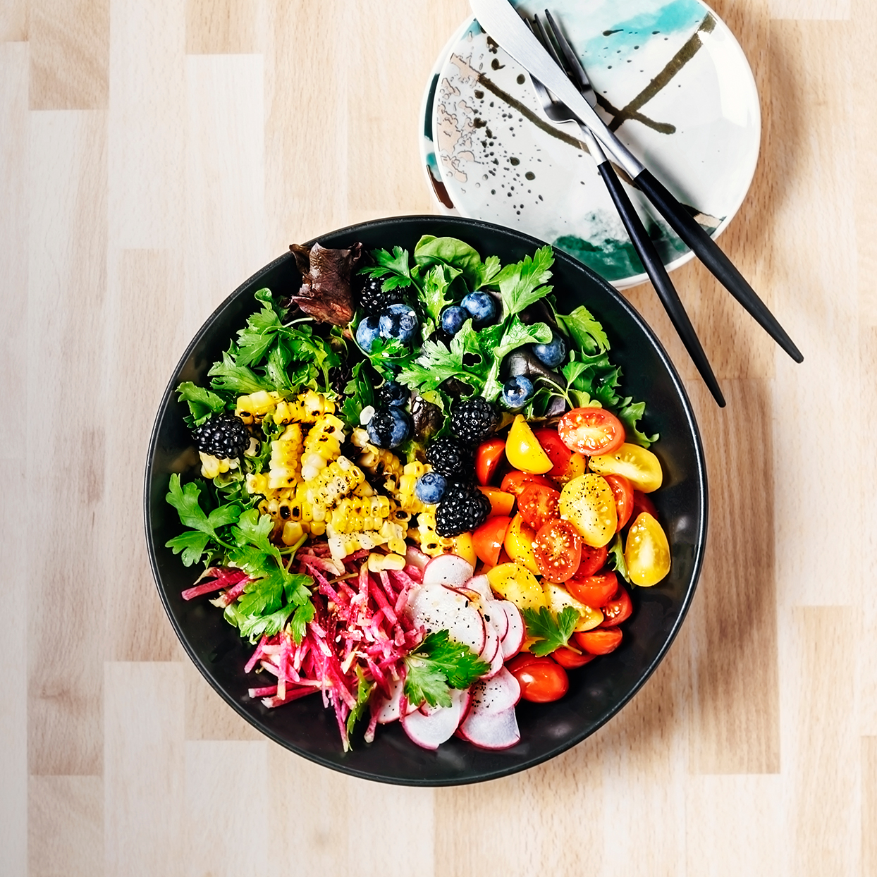 Bowl of fresh salad on wooden background