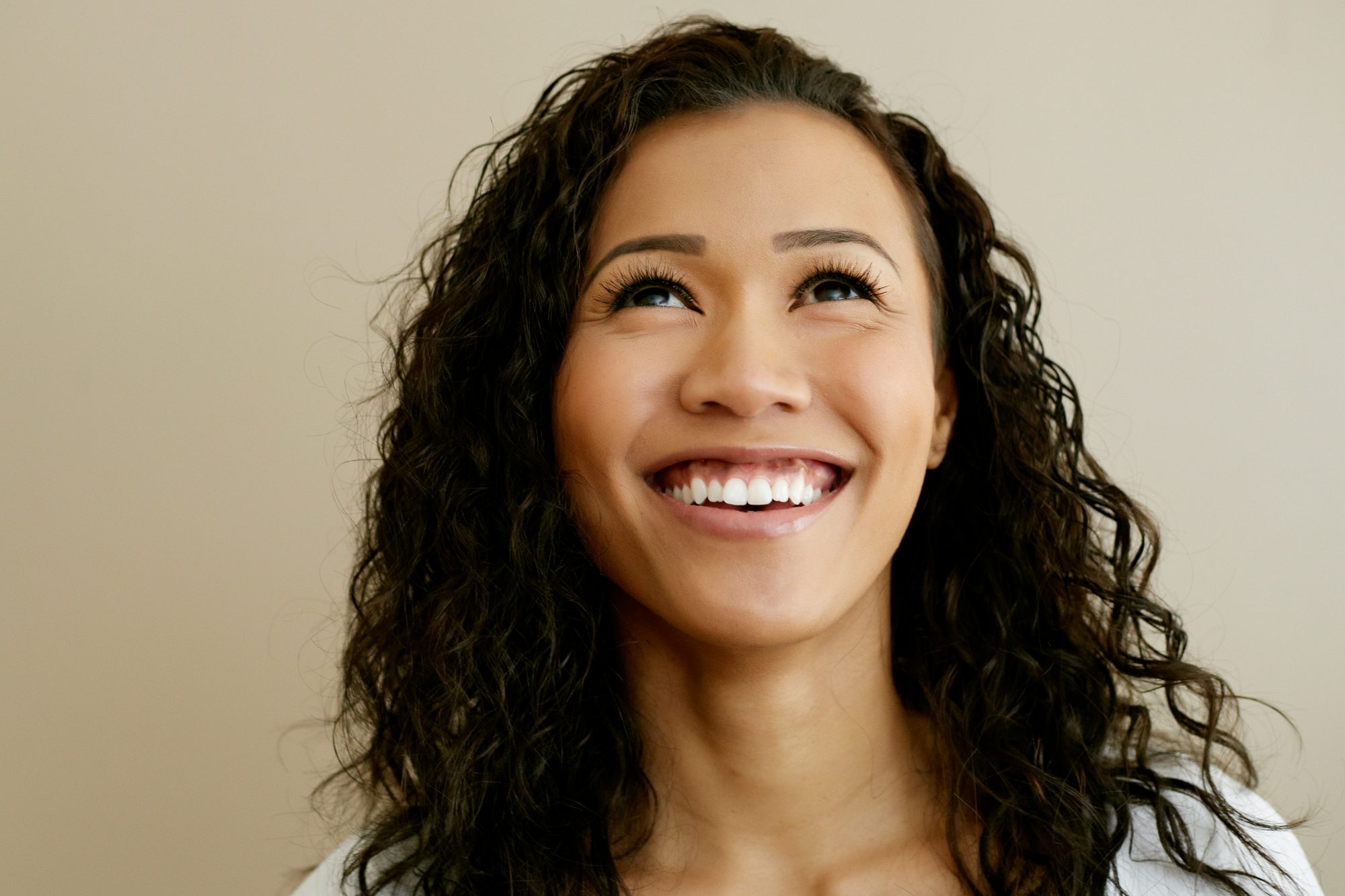 Woman smiling with long fluttery eyelashes