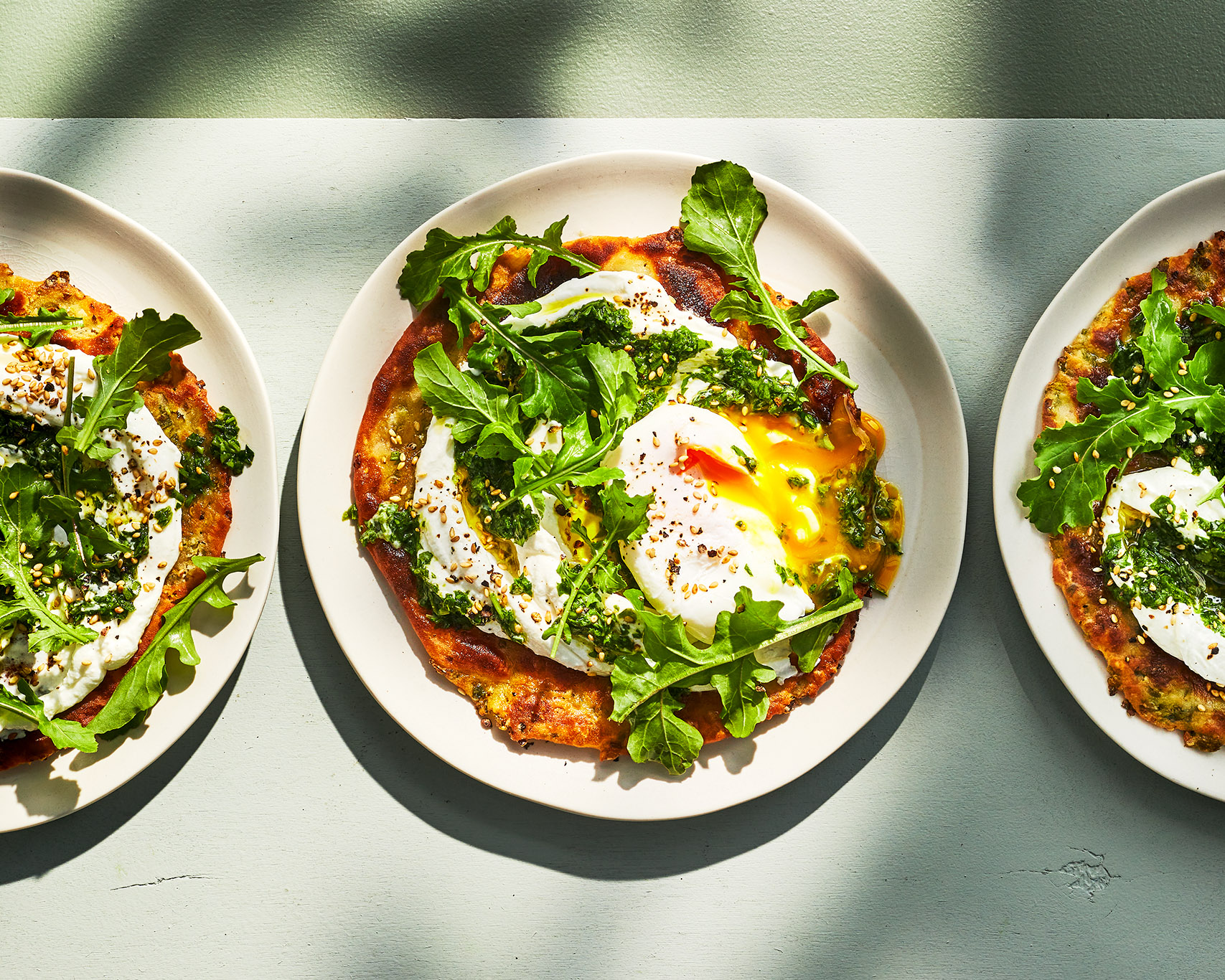 Spring Onion Flatbreads with Arugula, Zhug & Poached Eggs