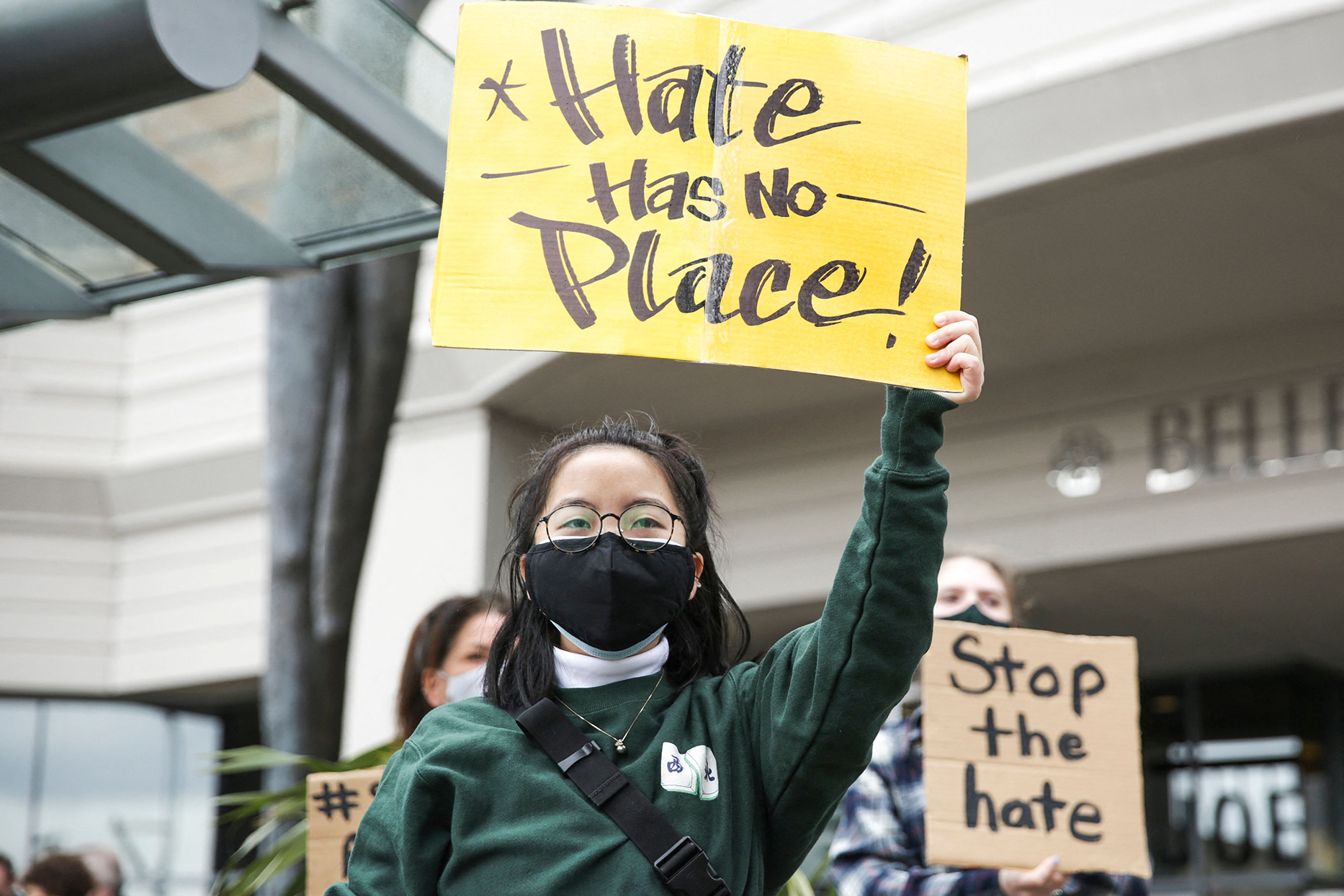A woman protesting the violence against the AAPI community