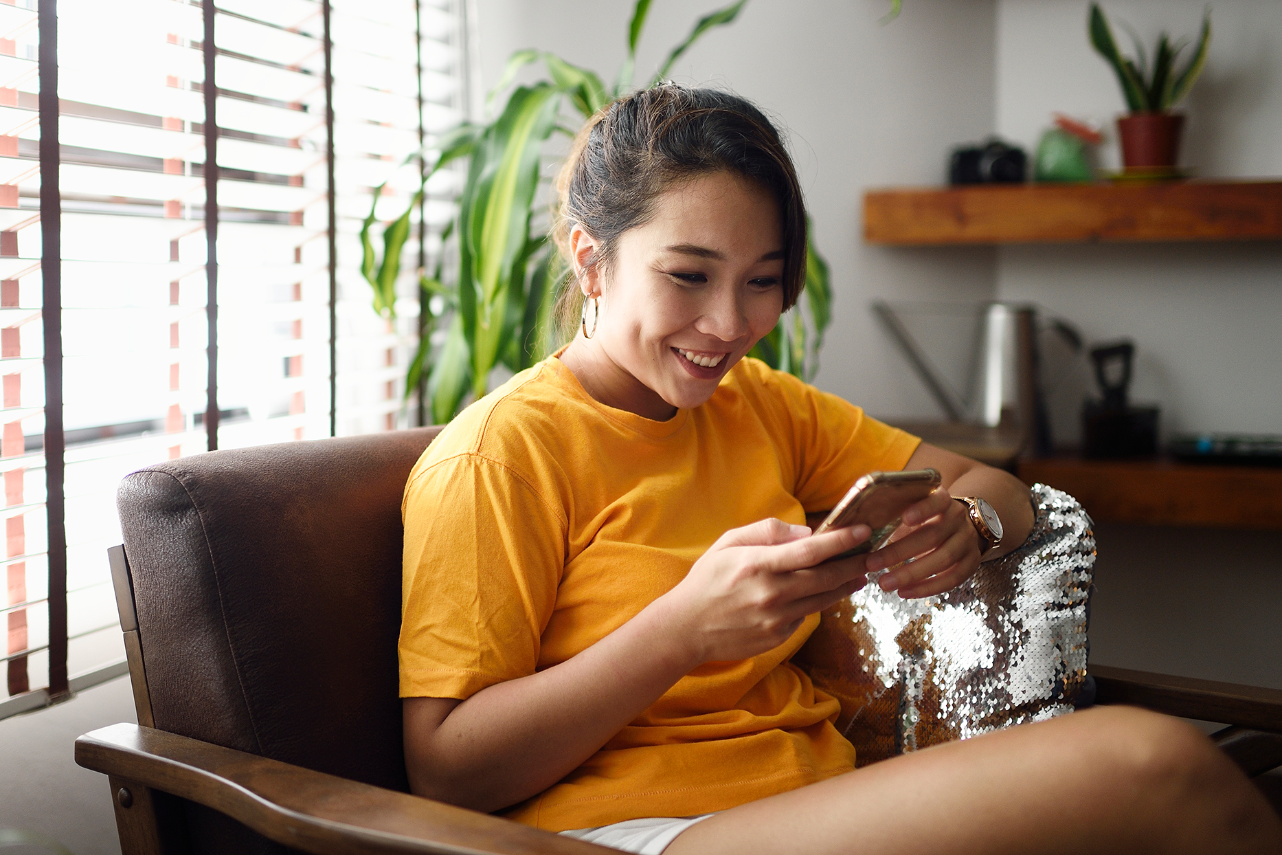 Woman using her smart phone at home