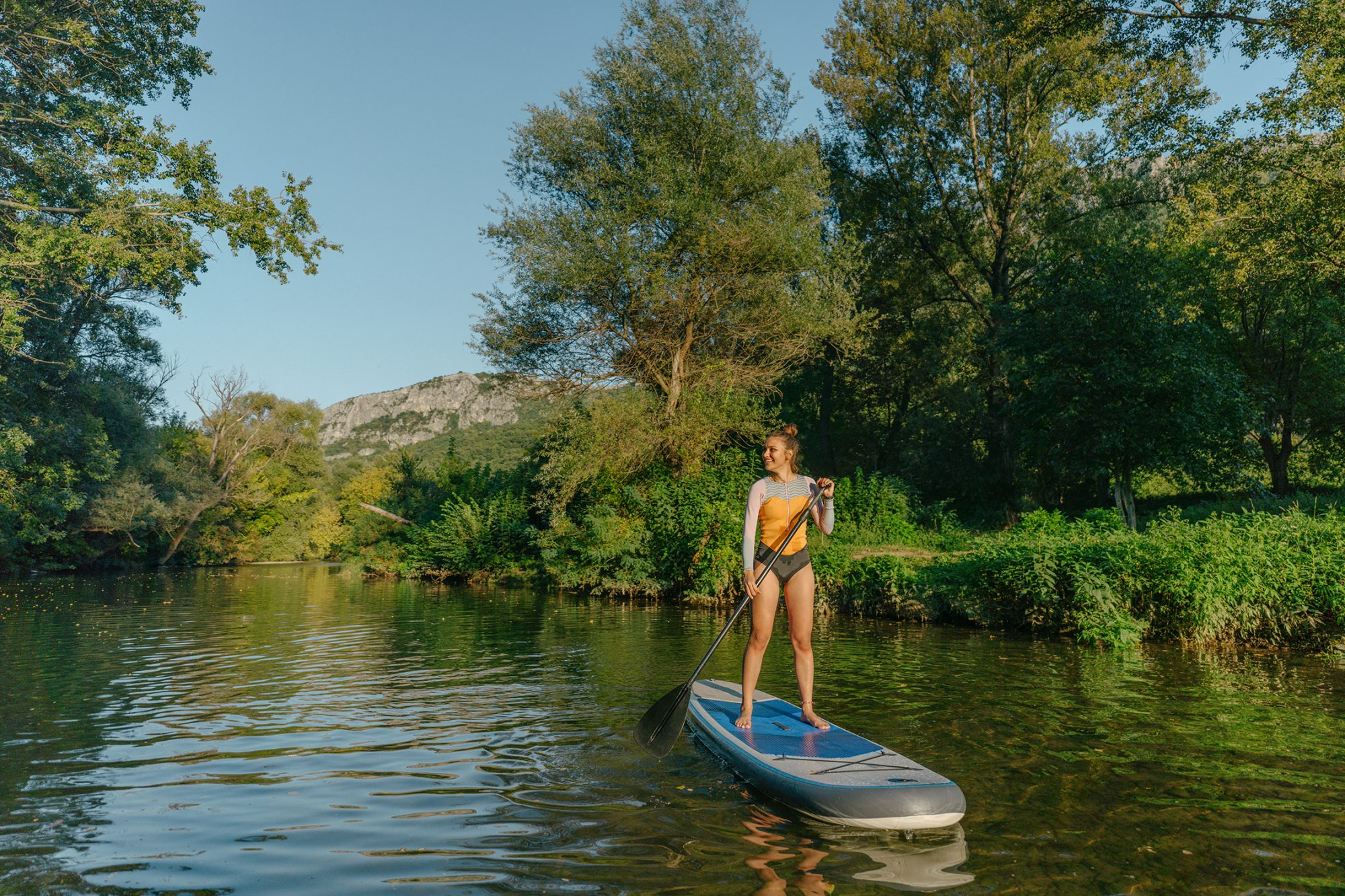 Woman using a stand-up paddleboard