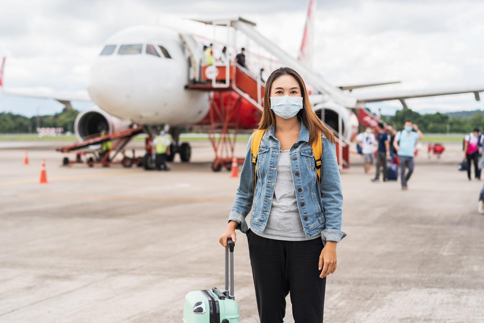 Portrait Of Woman Wearing Mask Standing On Airport