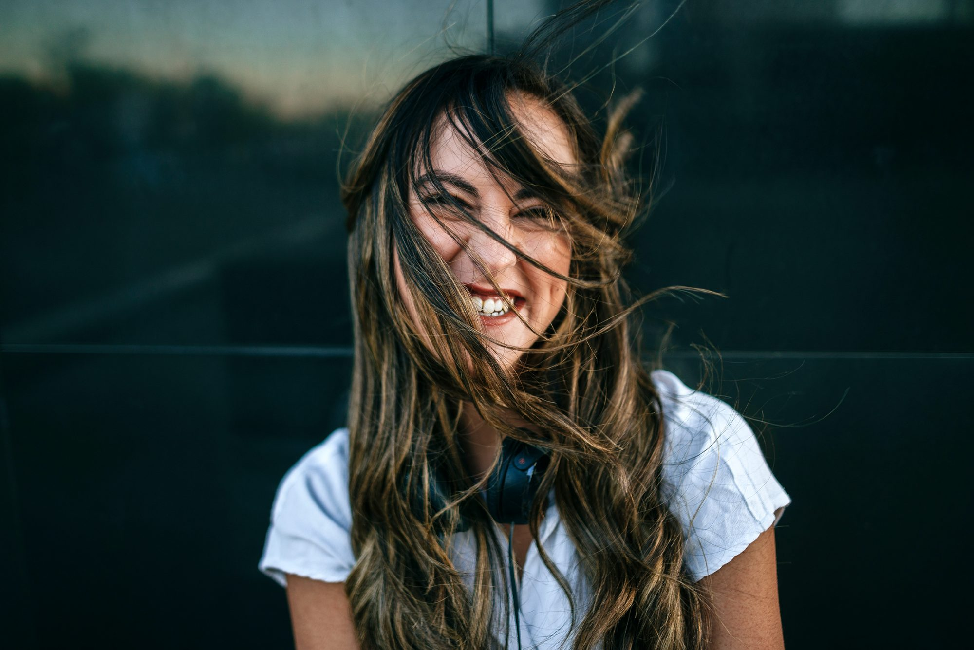 Laughing woman with hairs on her face, black background