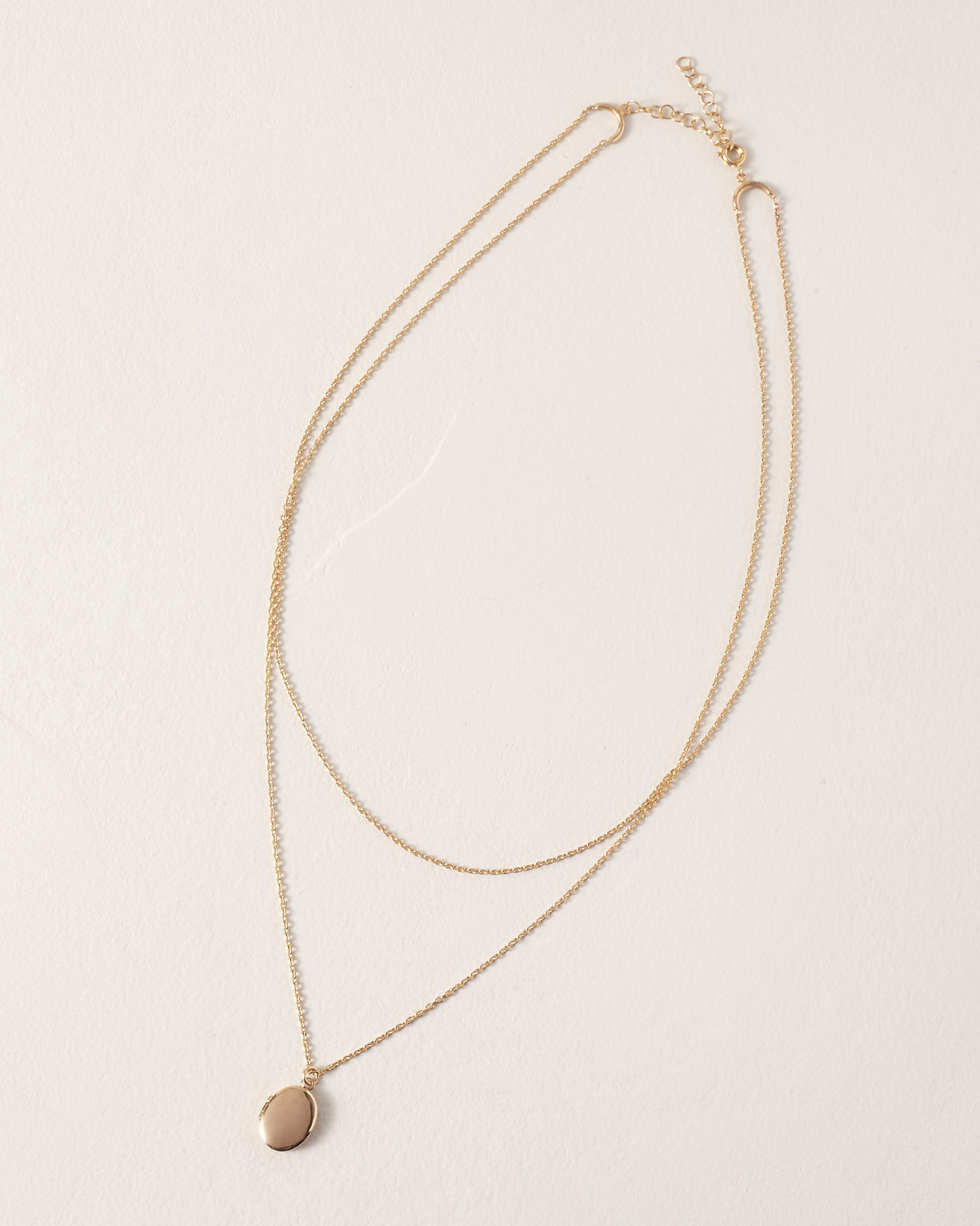 gold-plated locket delicate layered chain necklace