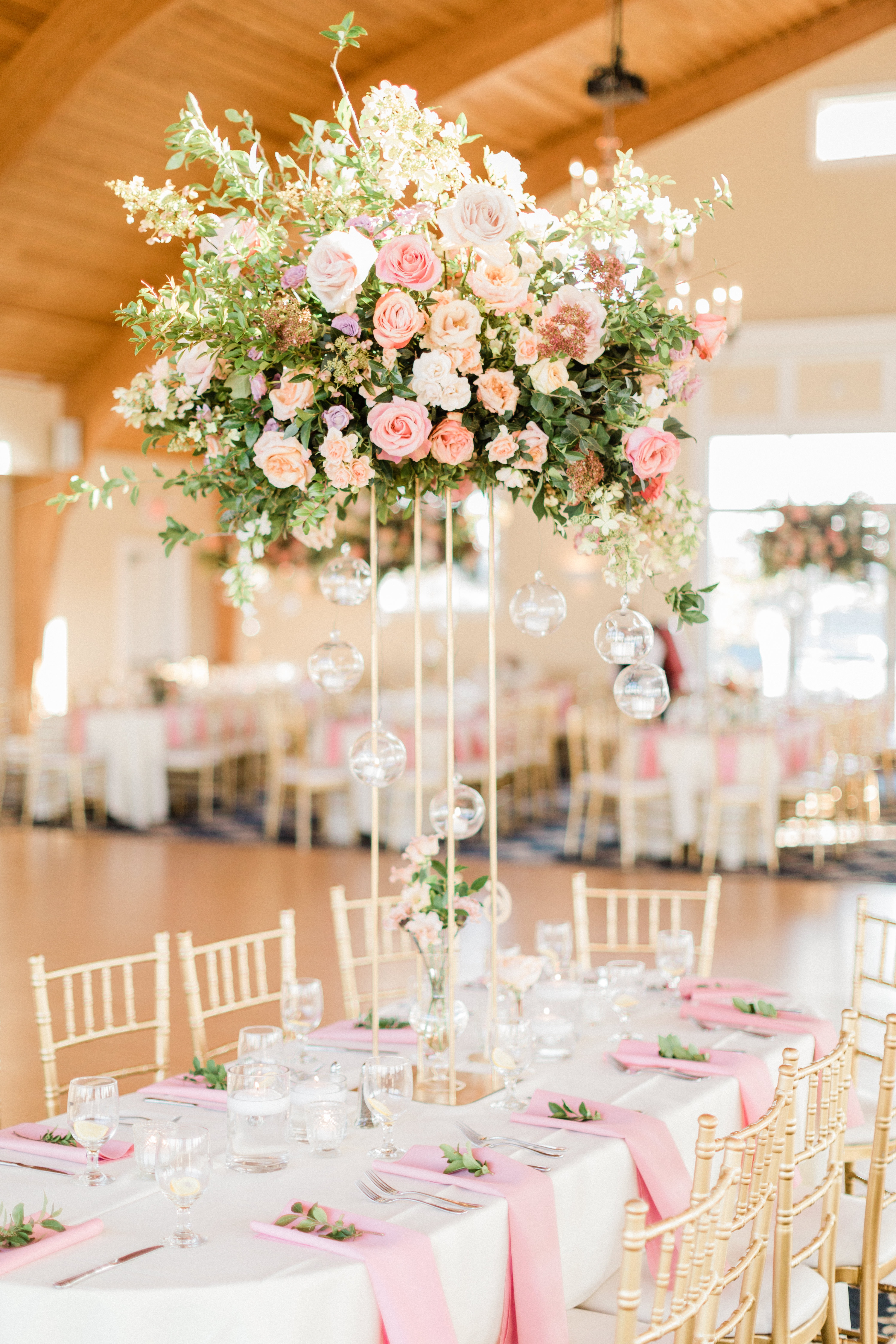 tall centerpiece with pink and white garden roses