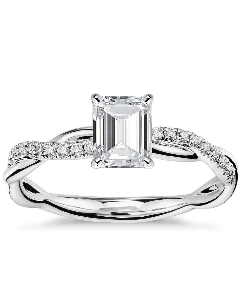 emerald cut ring with platinum and diamond set twist band