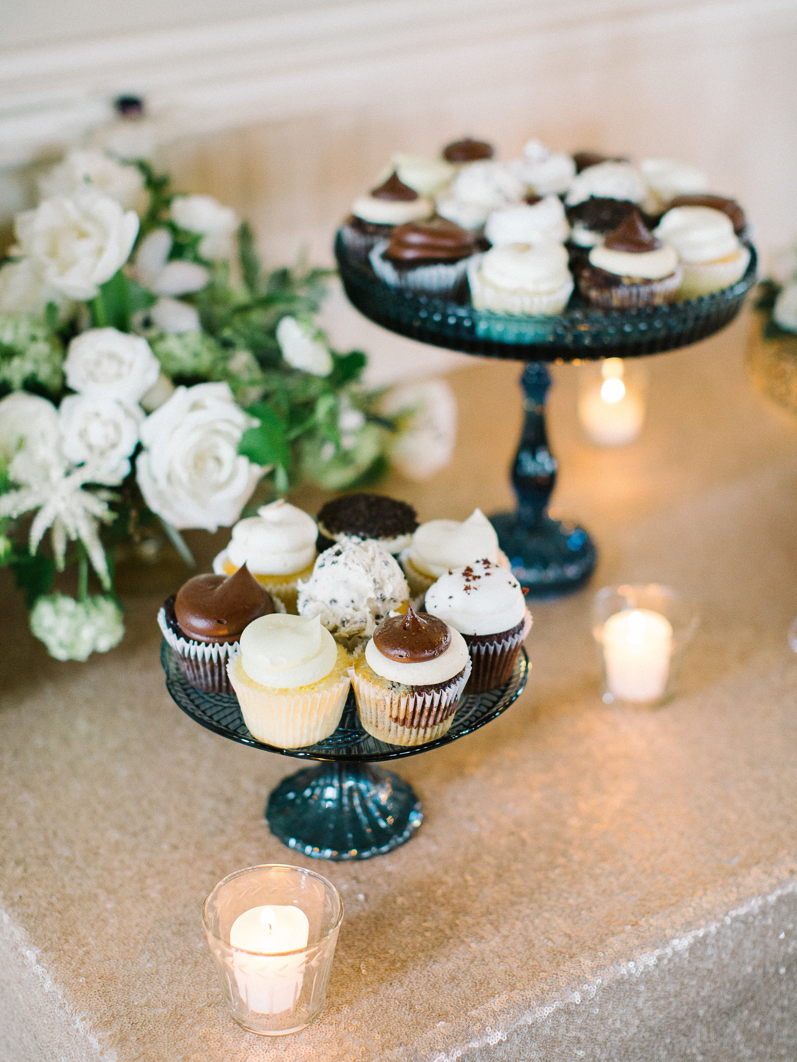chocolate and vanilla frosted cupcakes on a stand