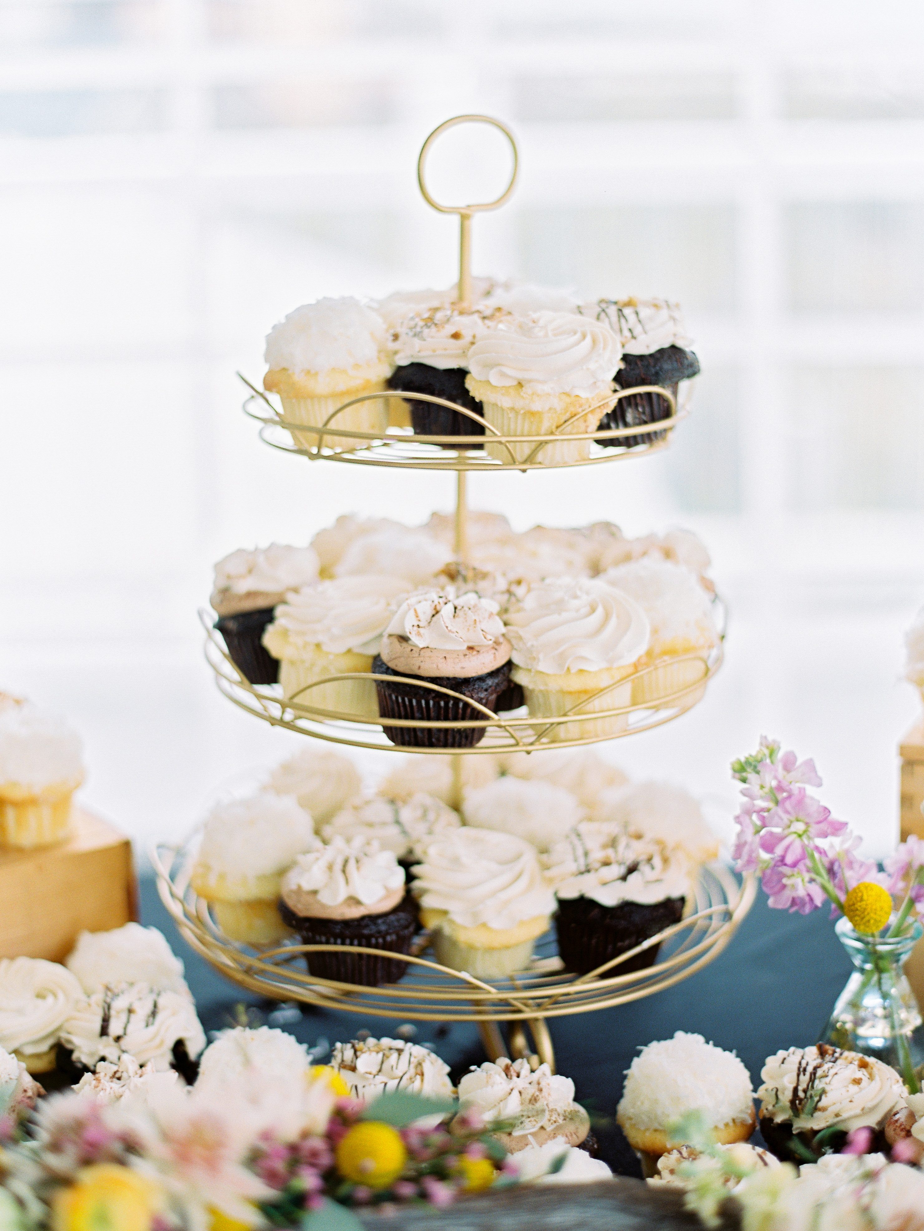 chocolate and vanilla cupcakes on a tier