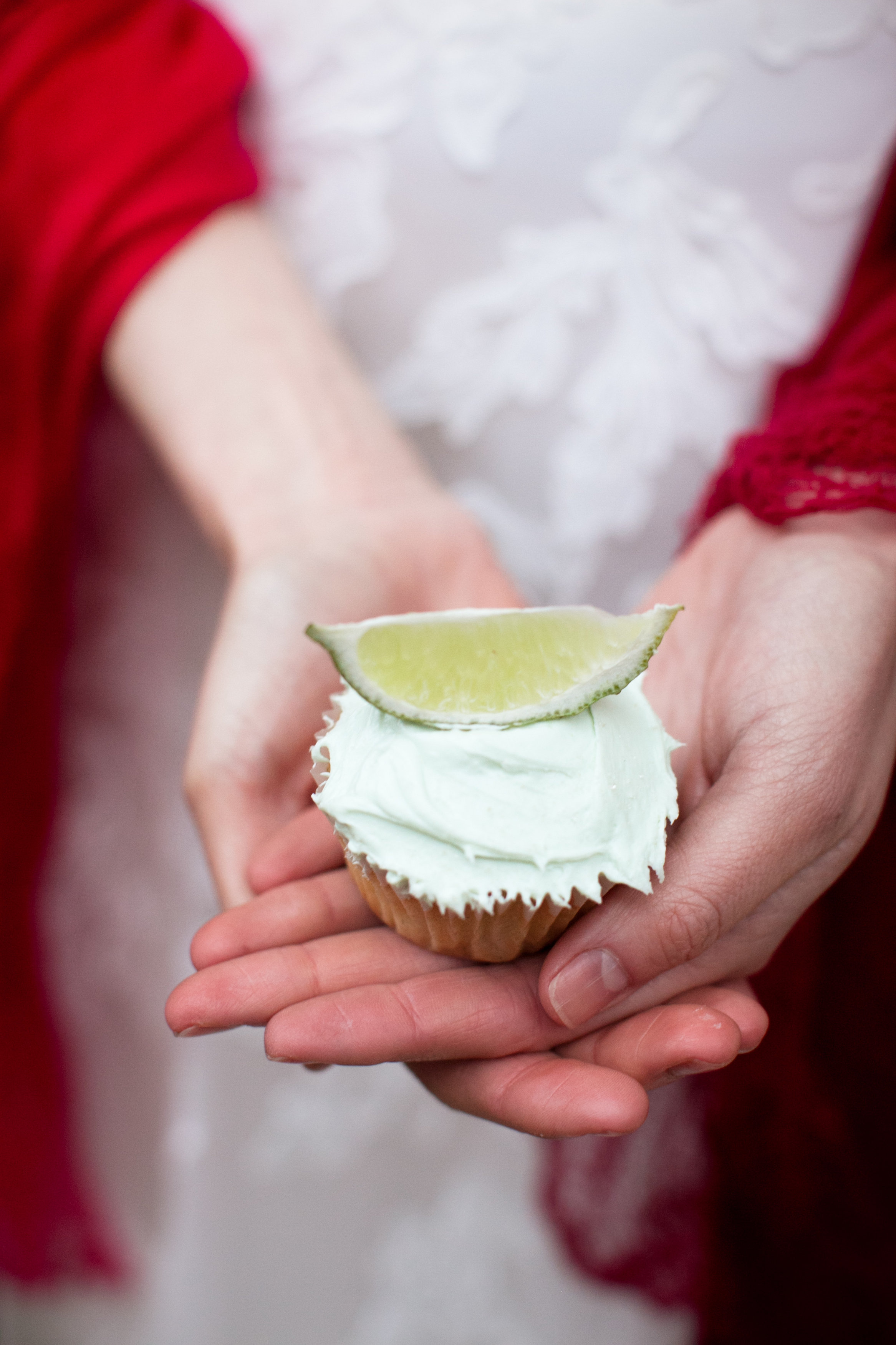 green frosted cupcake with lime on top