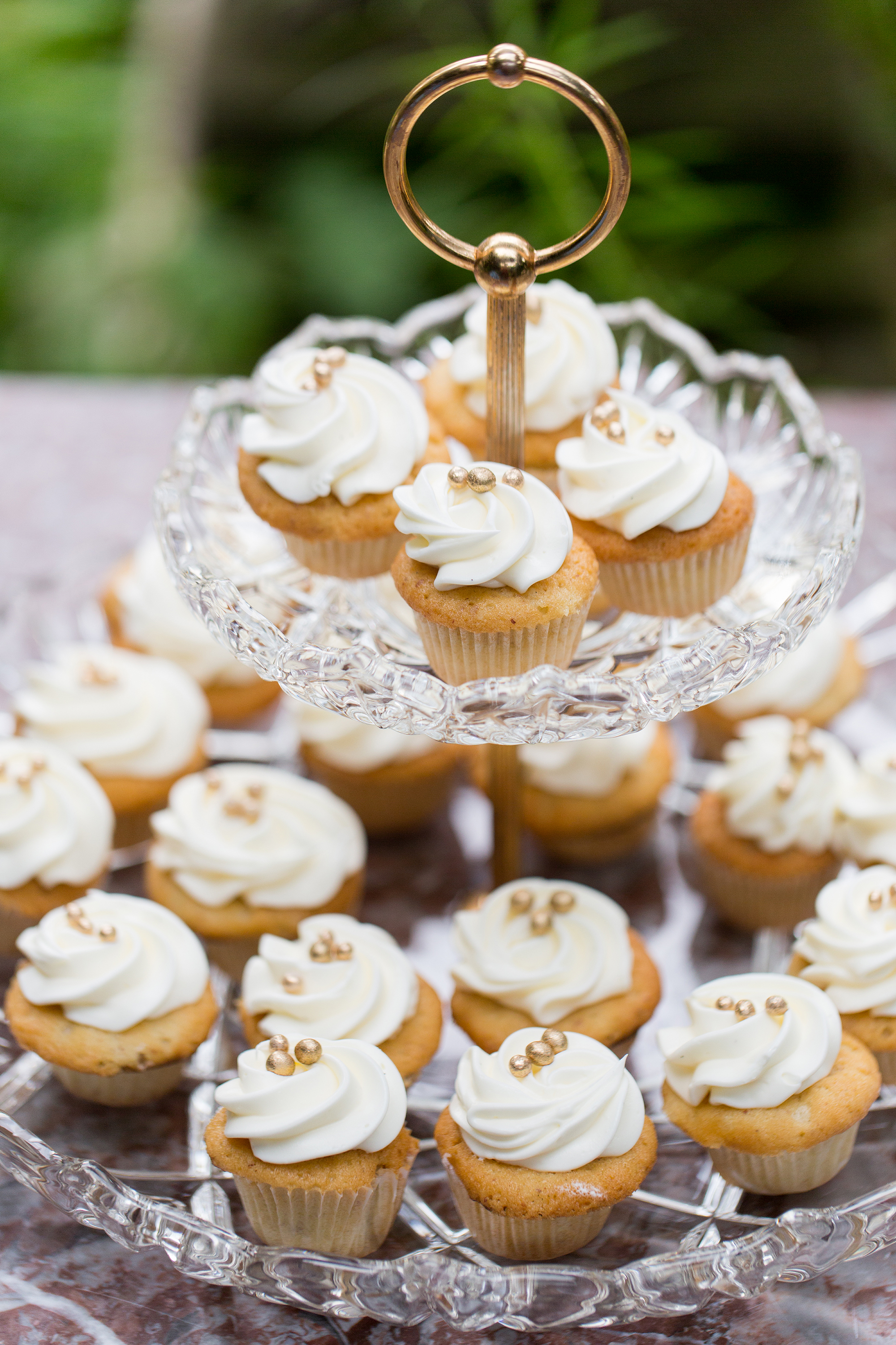 vanilla frosted cupcakes with gold pearls