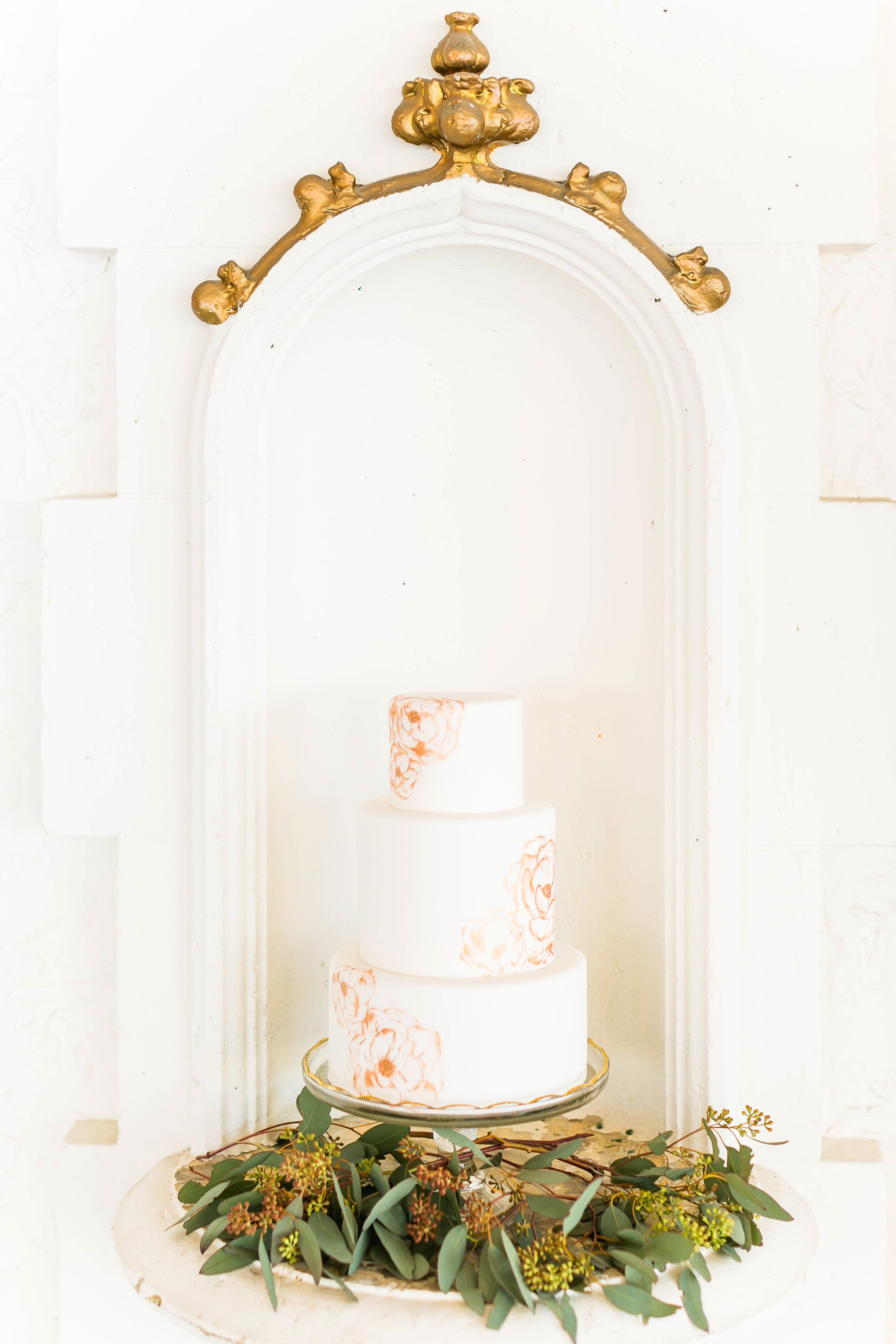 white painted wedding cake