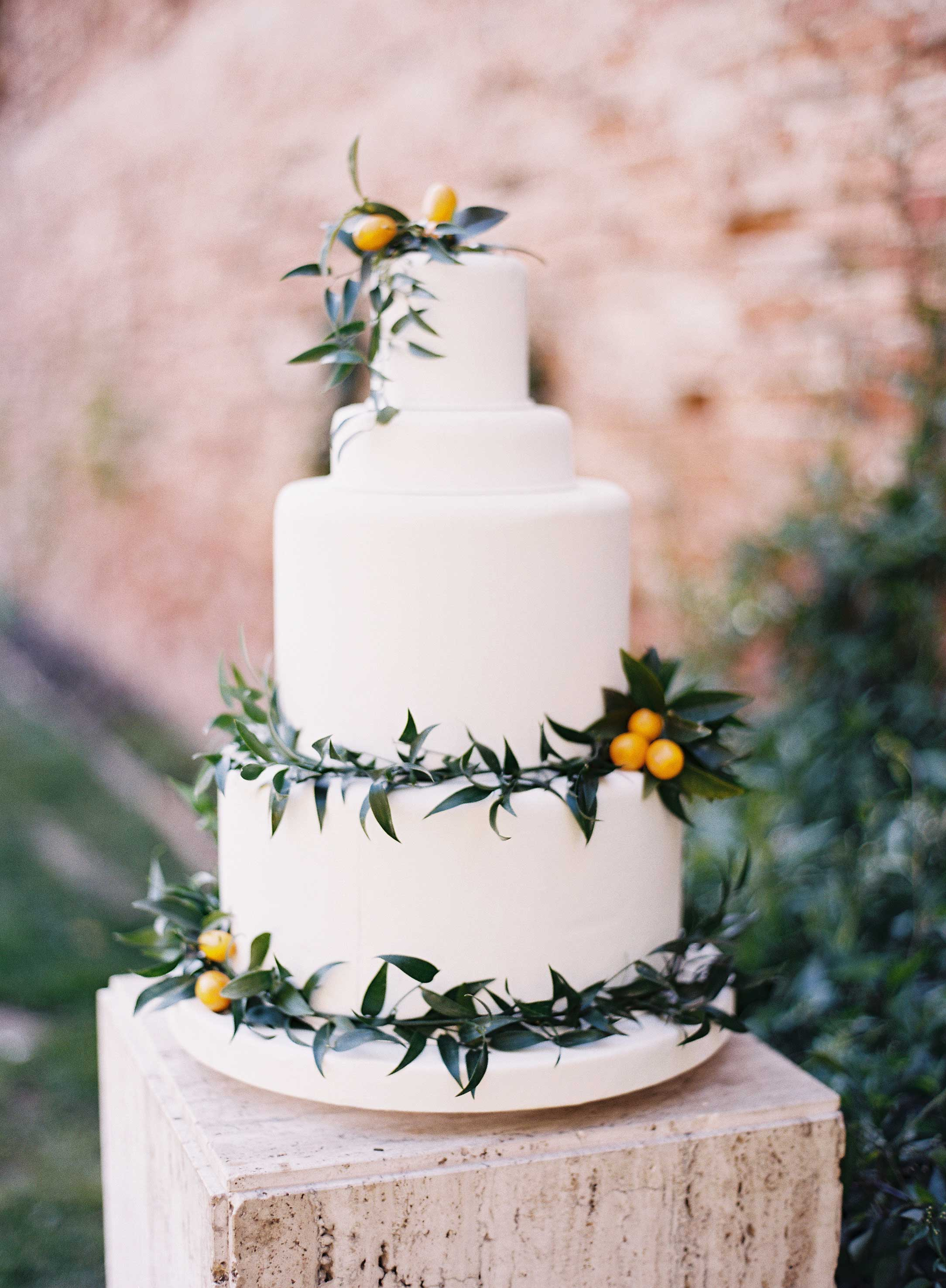 white cake with greenery