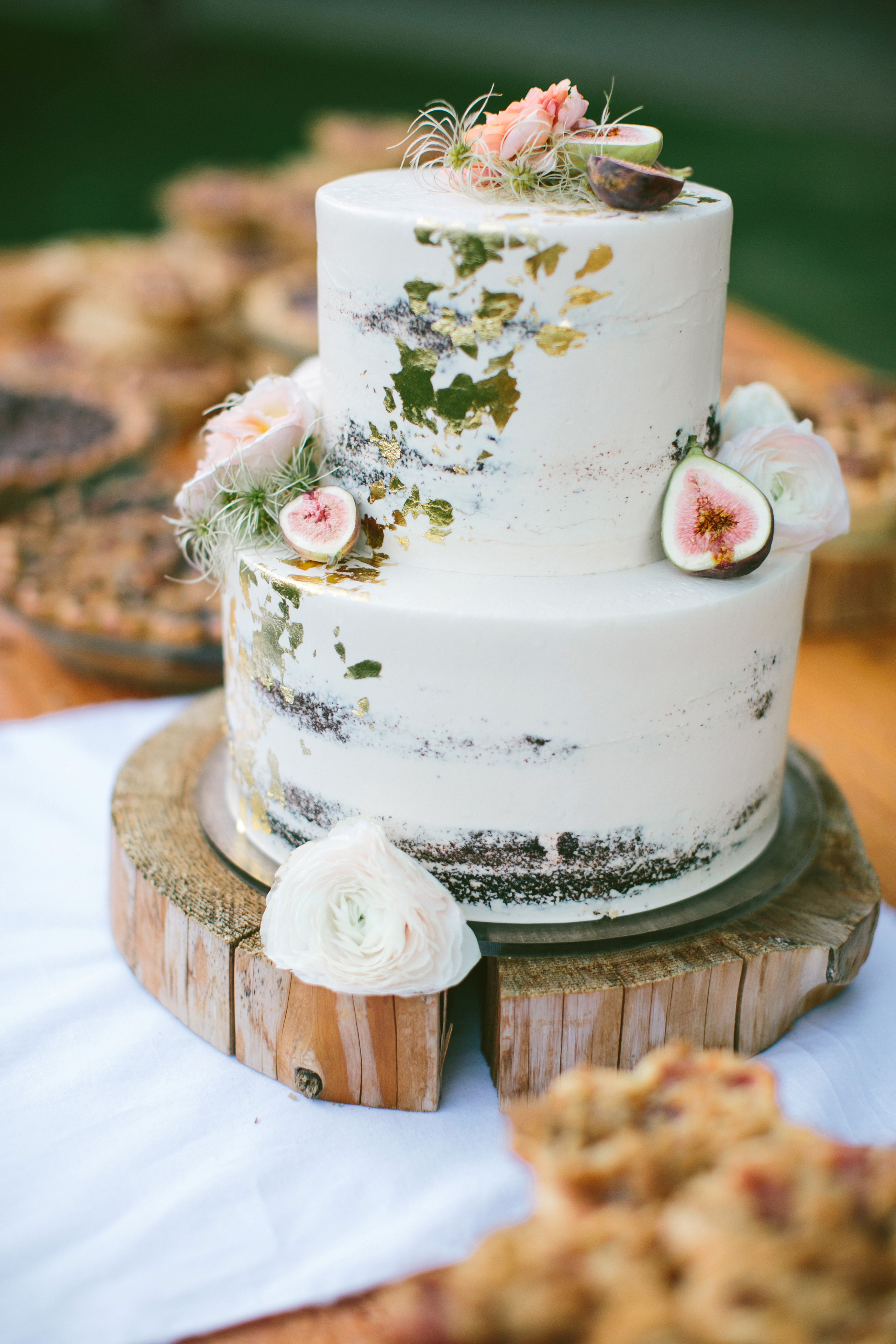 white layer cake gold leaf