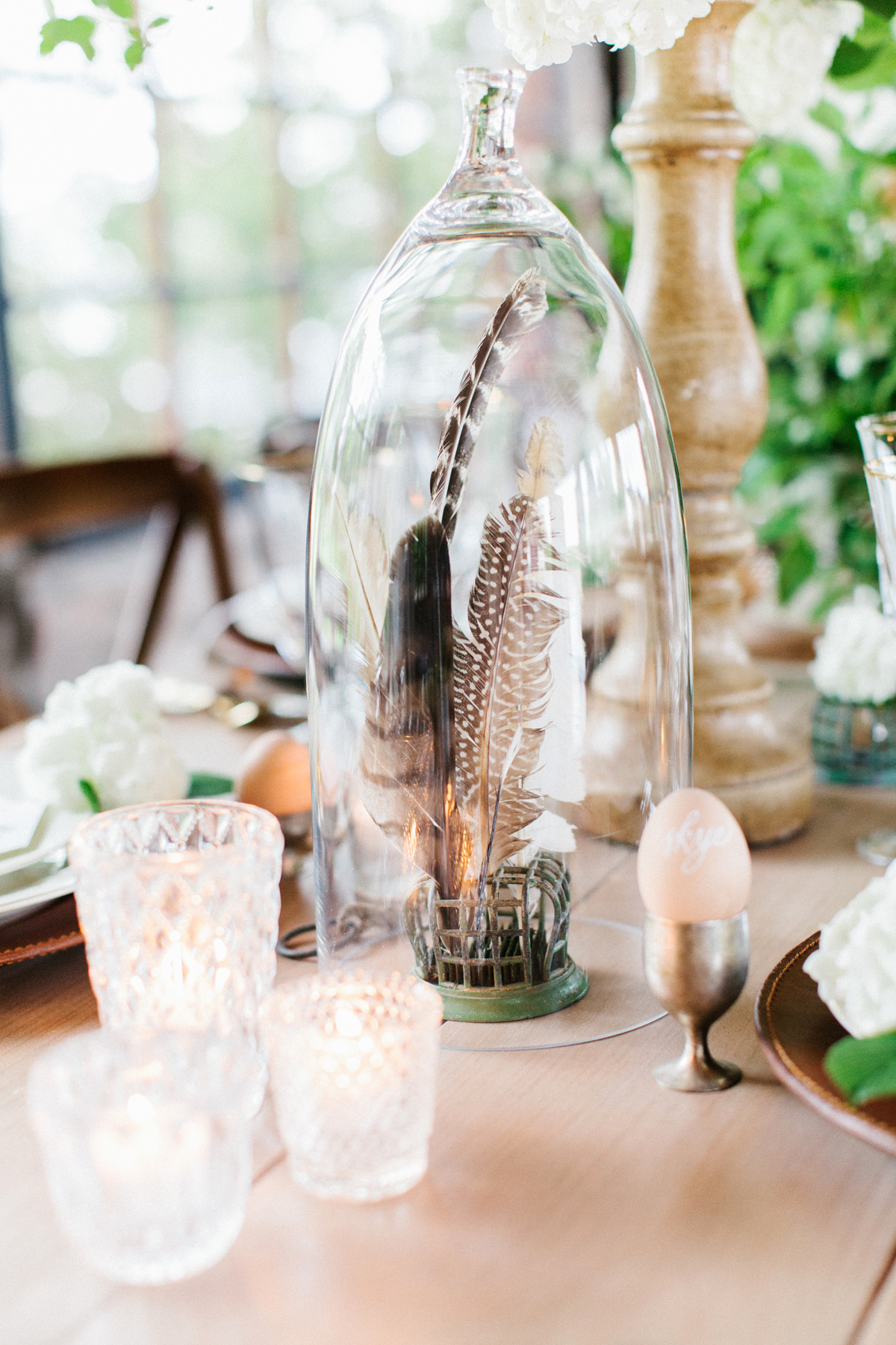 non-floral wedding centerpieces feathers in cloche