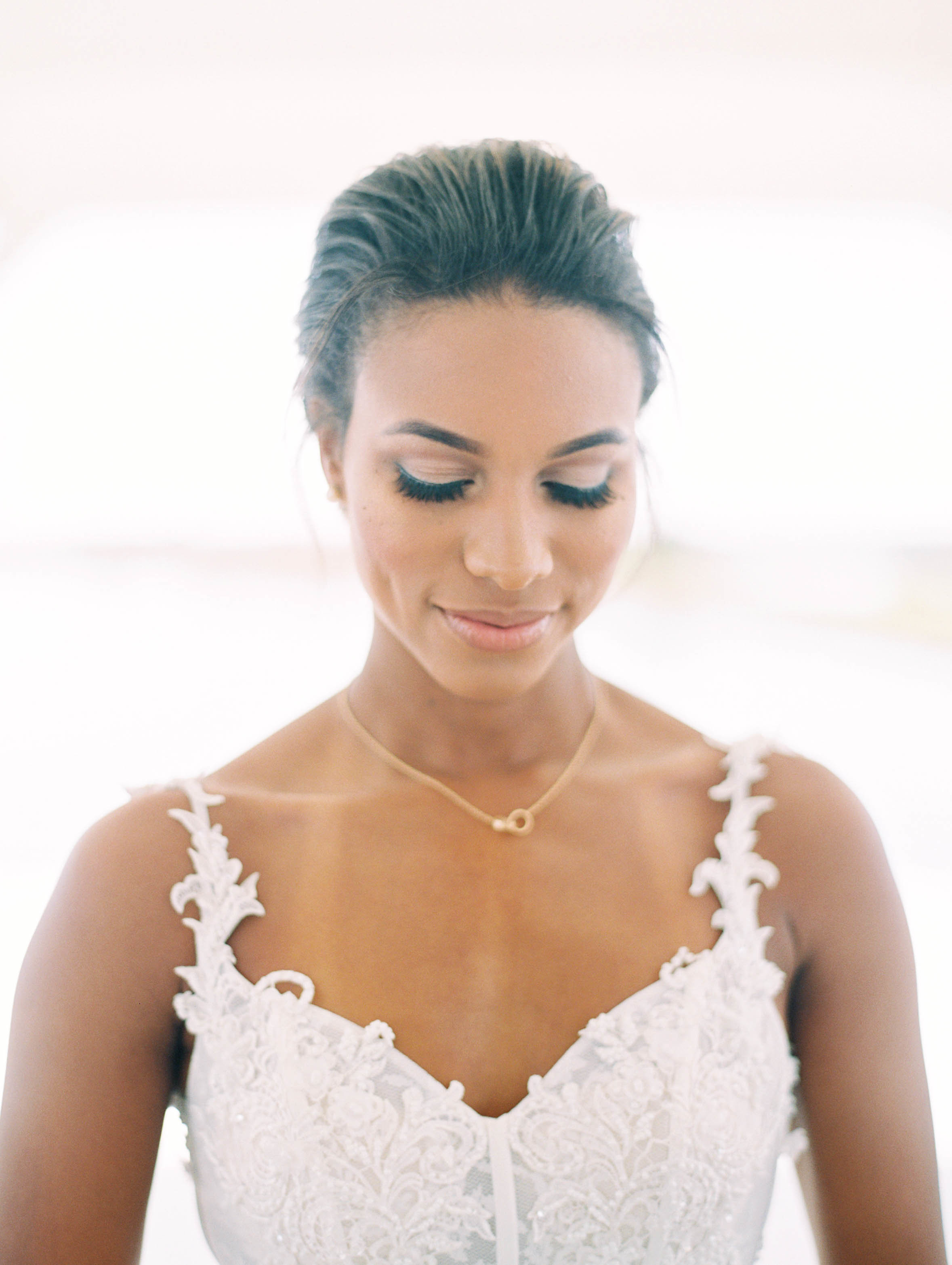 bride wearing sweetheart neckline and pendant necklace