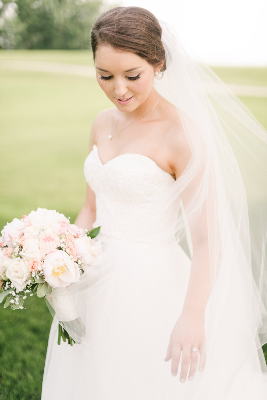 bride wearing necklace with drop pendant