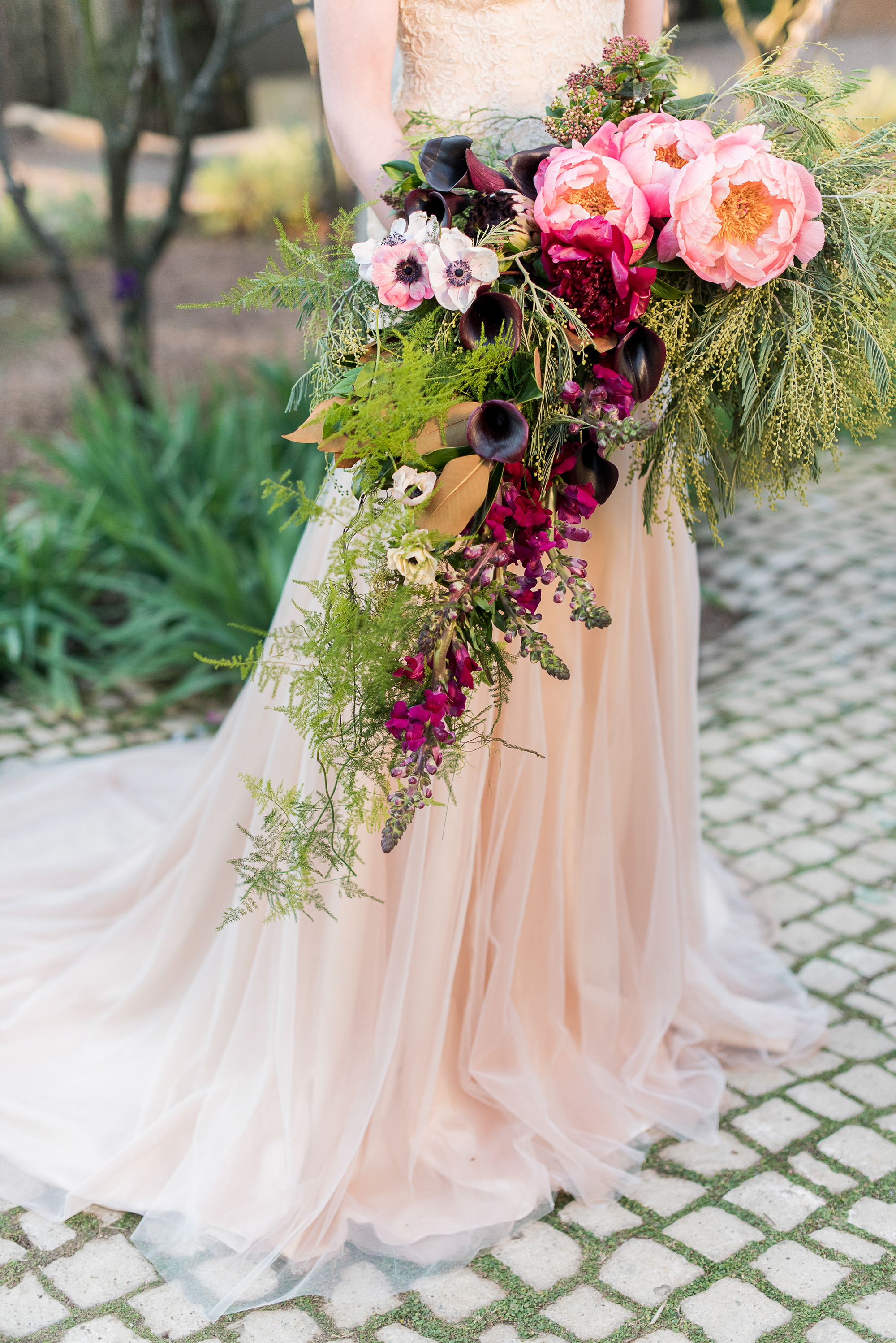 cascade bouquet with greenery calla lilies and anemones