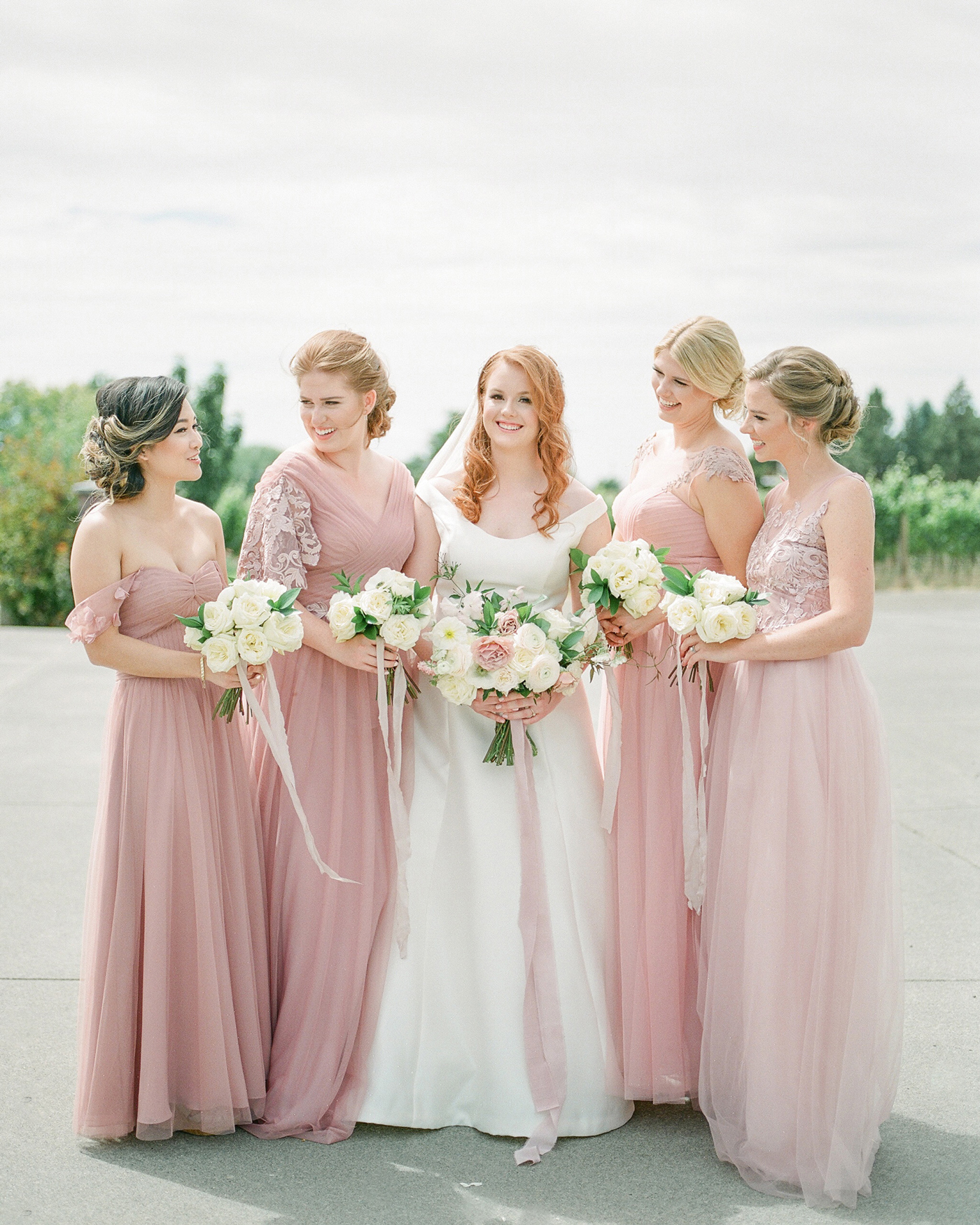 bridesmaids wearing blush colored gowns