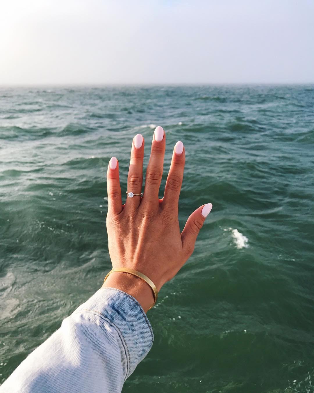 engagement ring selfie seascape