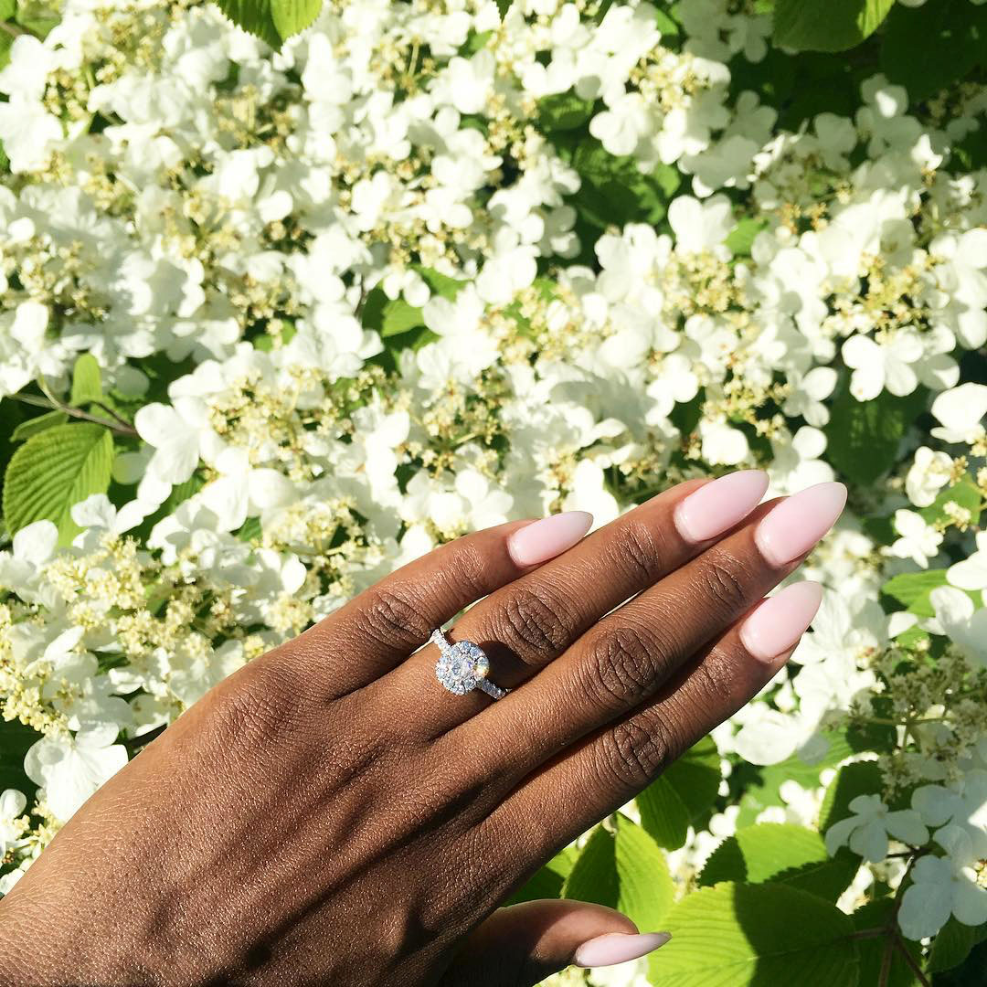 engagement ring selfie white flowers and greenery