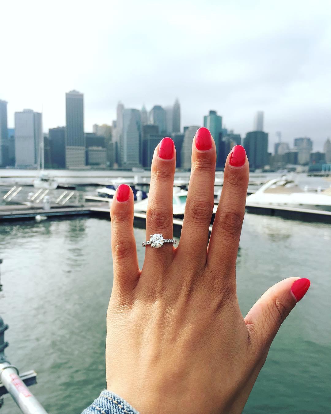 engagement ring selfie skyline view