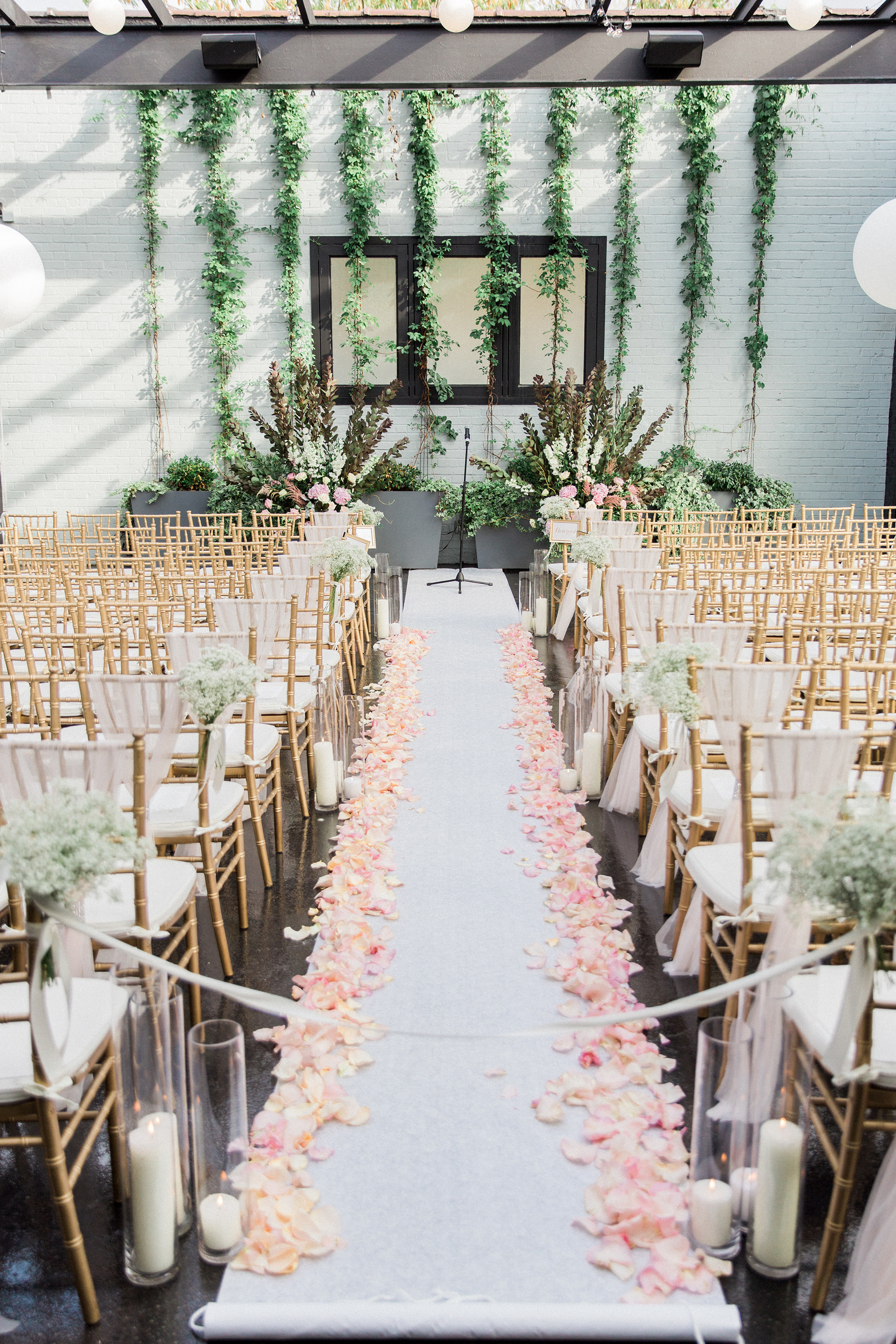 ceremony aisle with petals and greenery