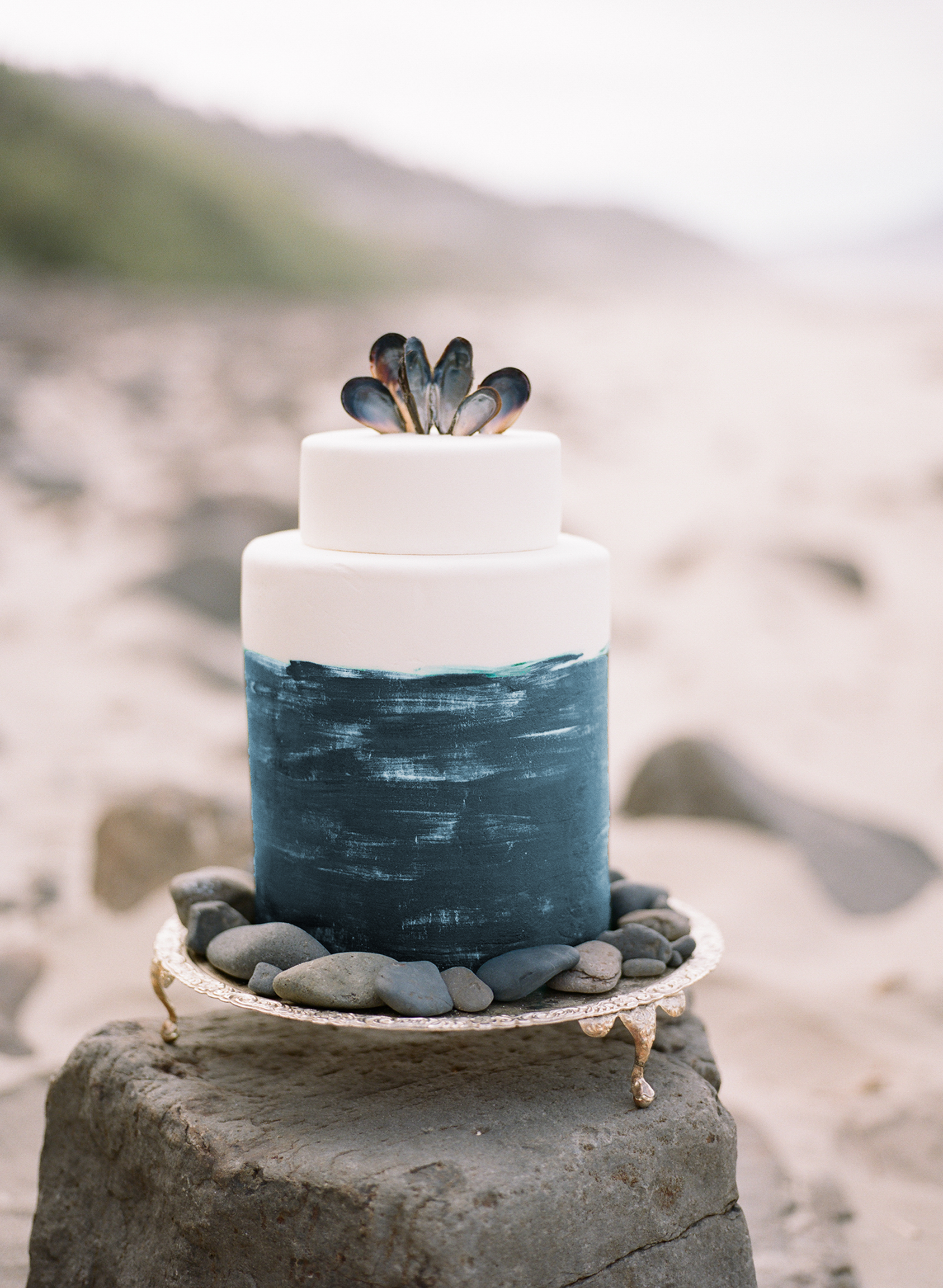 Blue and White Wedding Cake Topped with Shells