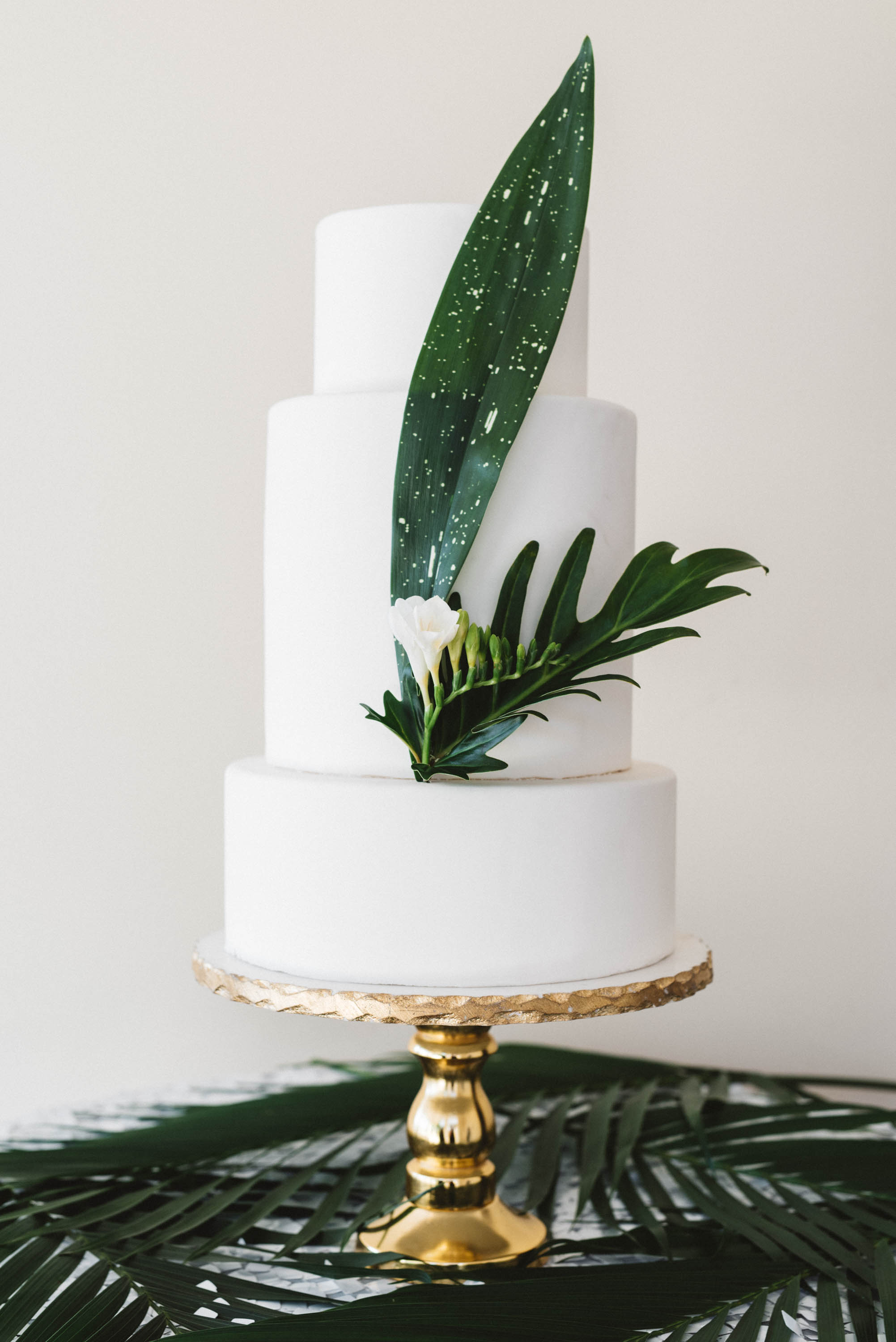 Three-Tiered White Cake with Tropical Leaves