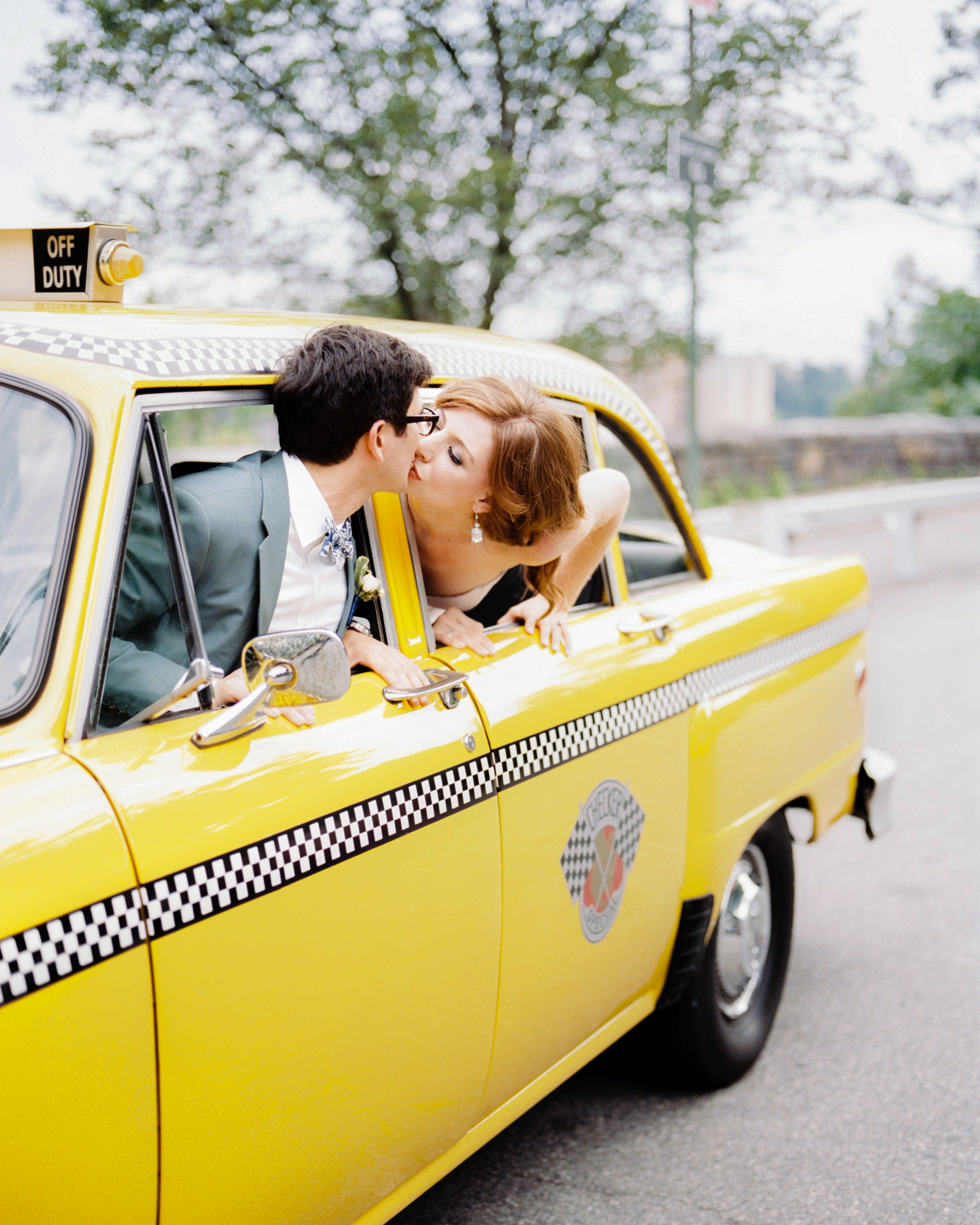 couple kissing in taxi cab