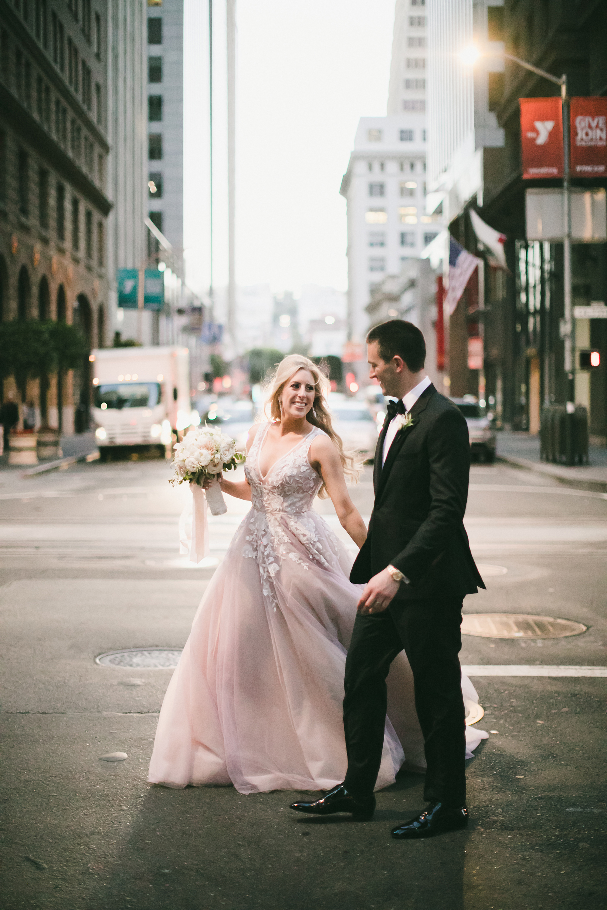 couple walking through streets of san francisco