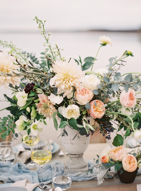 dahlia wedding centerpieces tall orange pink arrangement